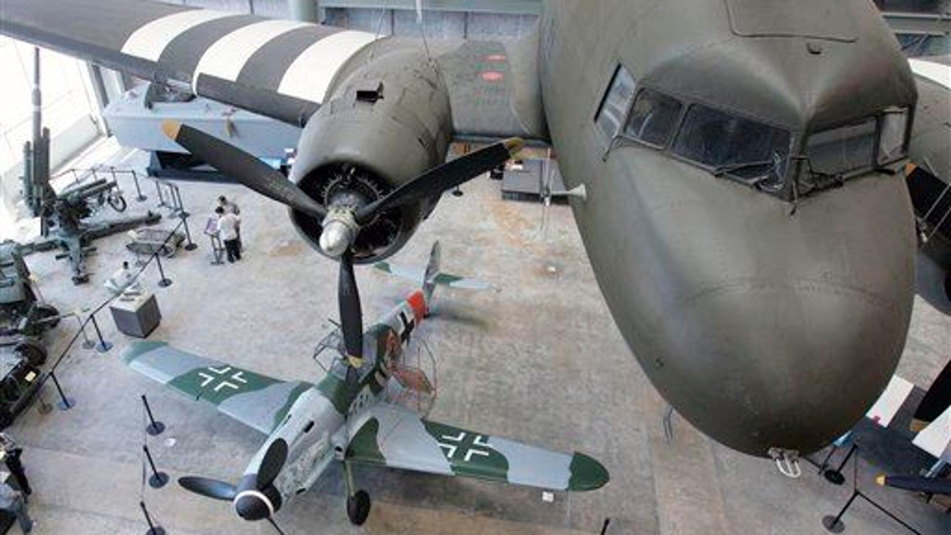 In this 2008 file photo, a German Messerschmitt Bf 109 sits beneath an American C-47 transport aircraft on display at the National World War II Museum in New Orleans.