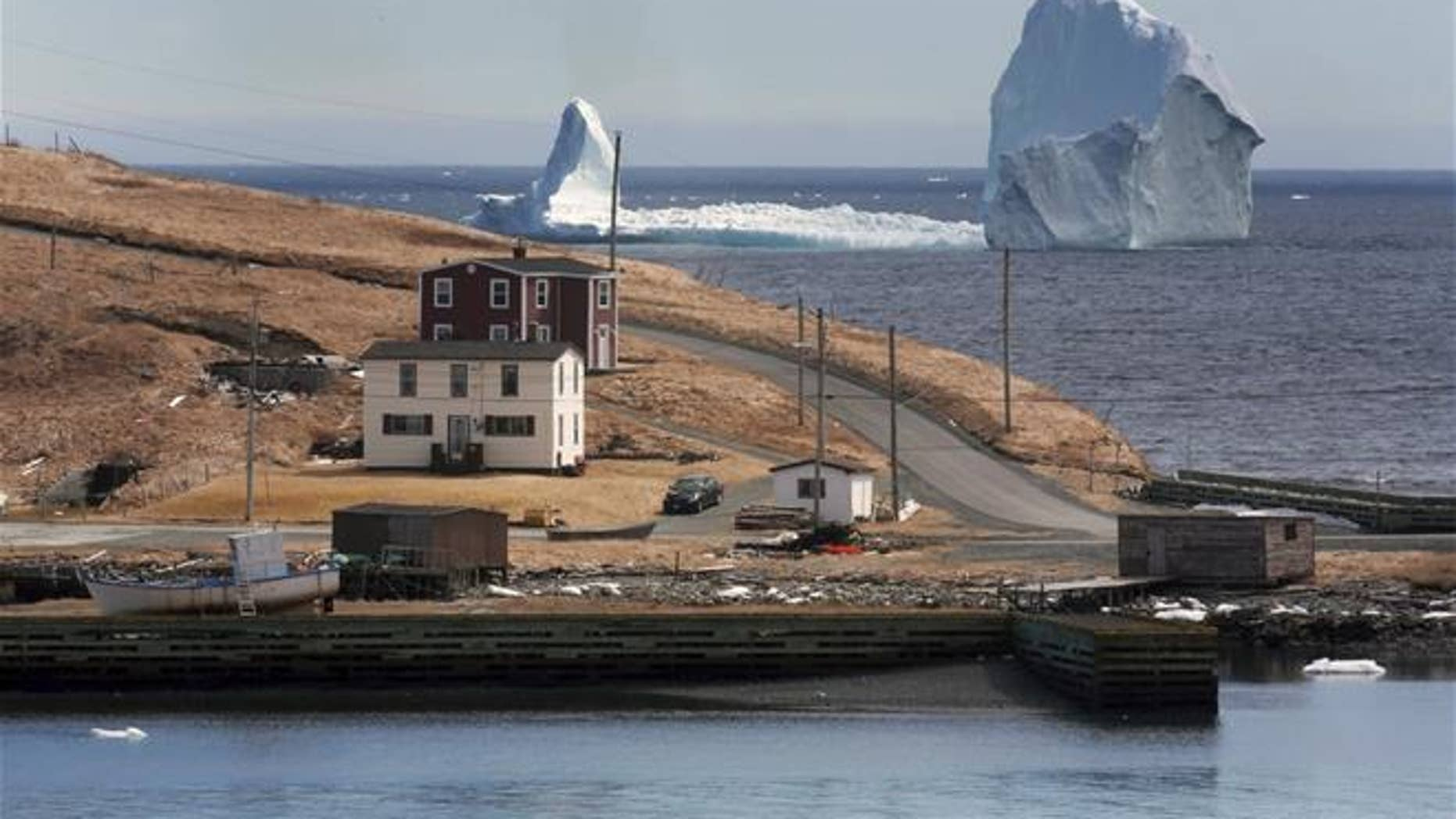 A large iceberg is visible from the shore in Ferryland, an hour south of St. John's, Newfoundland on Monday, April 10, 2017.