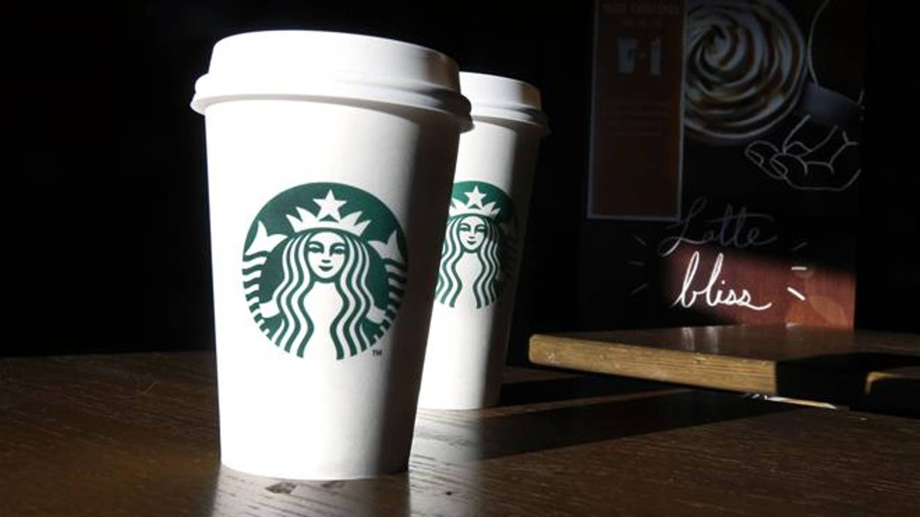 """She accused Starbucks of """"failing to adequately"""" fasten the lid."""