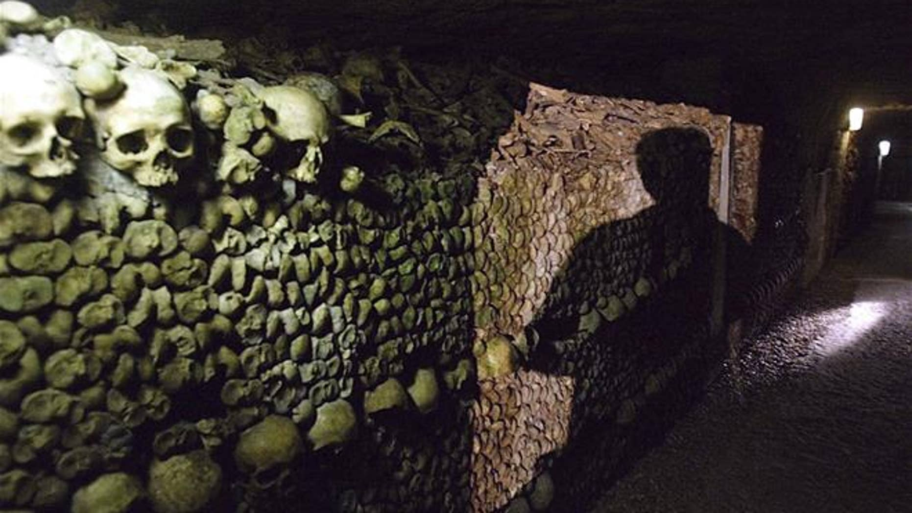 """French police say robbers broke into a wine collector's Paris cellar while he was away on vacation, breaking through the cellar wall via the famous """"Catacombs"""" network of passages under the city and making off with nearly $300,000 worth of vintage wines."""