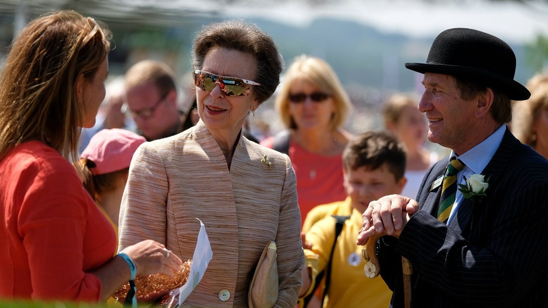 HRH Princess Anne, Princess Royal speaks with Emma Stothard (L) about her sculpture Craven Heifer as she visits during the second day of the 160th Great Yorkshire Show on July 11, 2018 in Harrogate, England.