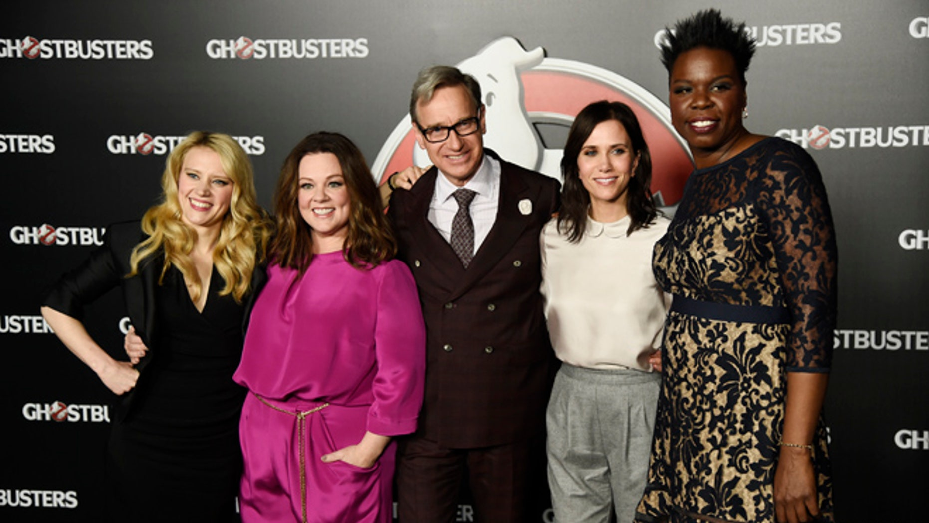 """FILE - In this April 12, 2016, file photo, director Paul Feig, center, poses with cast members, from left, Kate McKinnon, Melissa McCarthy, Kristen Wiig and Leslie Jones during the Sony Pictures Entertainment presentation of """"Ghostbusters,"""" at CinemaCon 2016 in Las Vegas. The film will be released nationwide on Friday, July 15. (Photo by Chris Pizzello/Invision/AP, File)"""