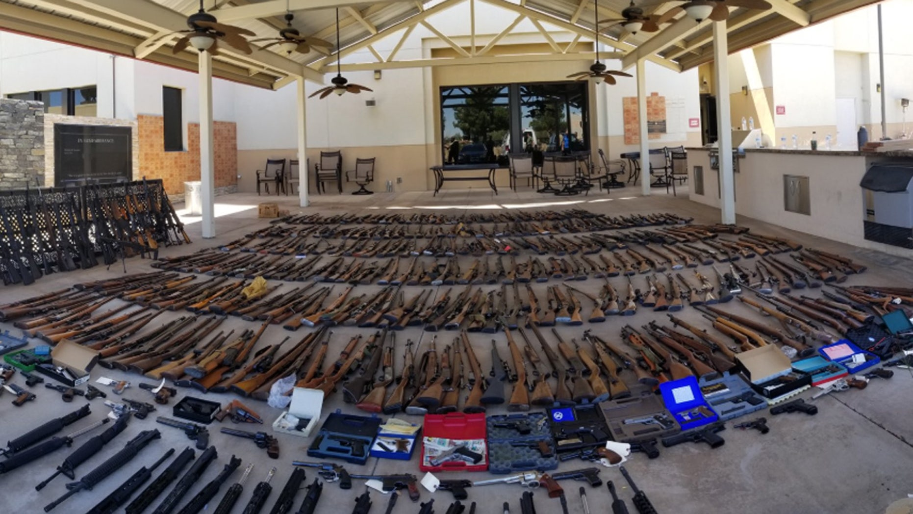 Authorities have seized more than 550 guns at two Southern California homes