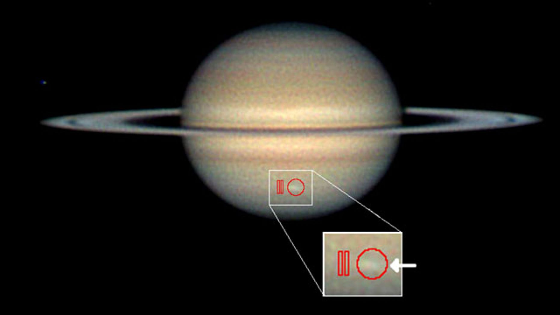 Amateur astronomer Christopher Go took this image of the storm on March 13, 2010. The arrow indicates the location of the storm and the red outlines show where Cassini's composite infrared spectrometer gathered data.