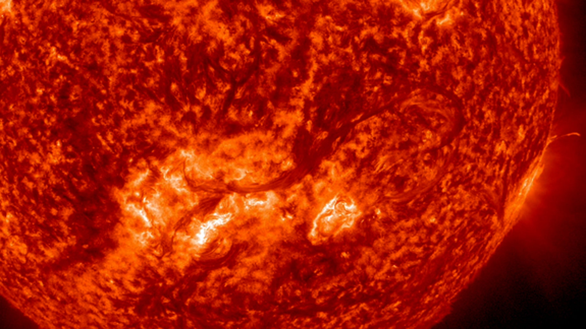 This image from NASA's Solar Dynamics Observatory (SDO) shows a long, whip-like solar filament extending over 500,000 miles in a long arc above the sun's surface between Aug. 6-8, 2012