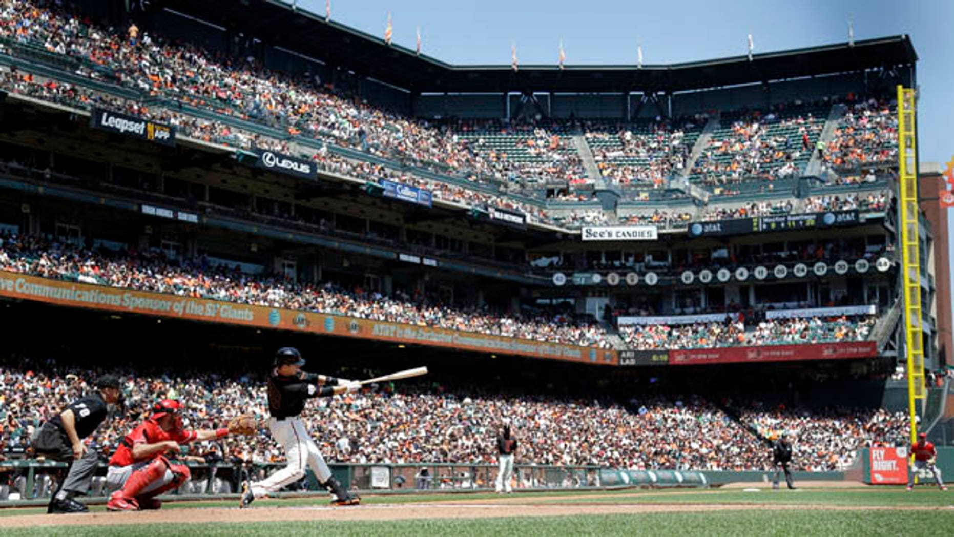 May 2, 2015: San Francisco Giants' Buster Posey hits a double against the Los Angeles Angels in San Francisco.