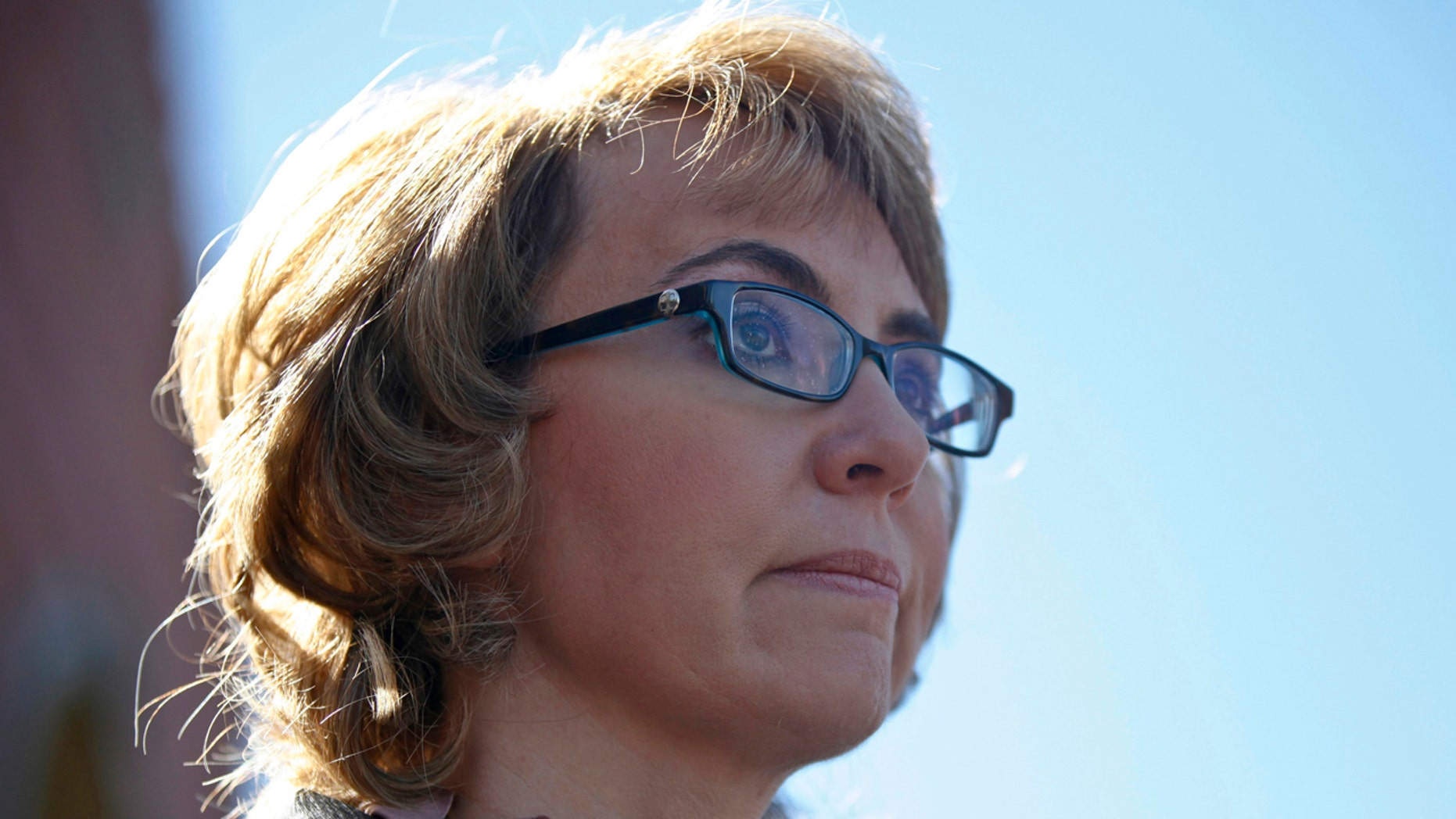 Former congresswoman Gabrielle Giffords addresses a news conference for victims of the January 8, 2011 Tucson shooting, at the Safeway grocery store parking lot where Giffords was shot during the incident in Tucson March 6, 2013.