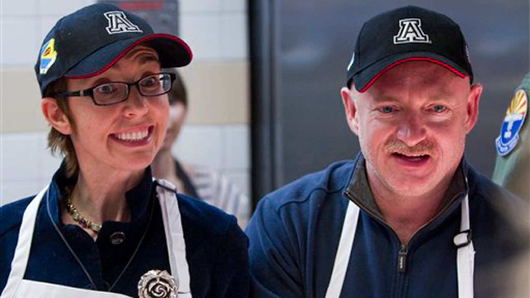 Nov. 24, 2011: Rep Gabrielle Giffords and her husband, retired Capt. Mark Kelly, serve a Thanksgiving meal to troops at Davis-Monthan Air Force Base in Tucson, Ariz.