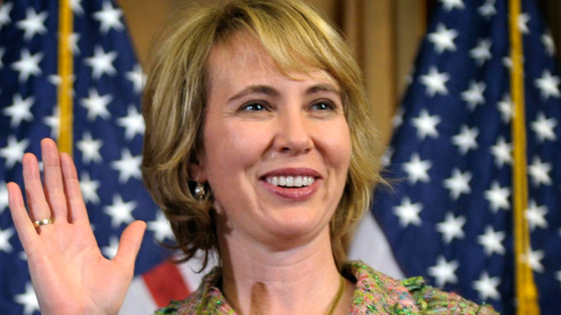 A Jan. 5, 2011 file photo shows Rep. Gabrielle Giffords, D-Ariz., taking part in a reenactment of her swearing-in on Capitol Hill in Washington.