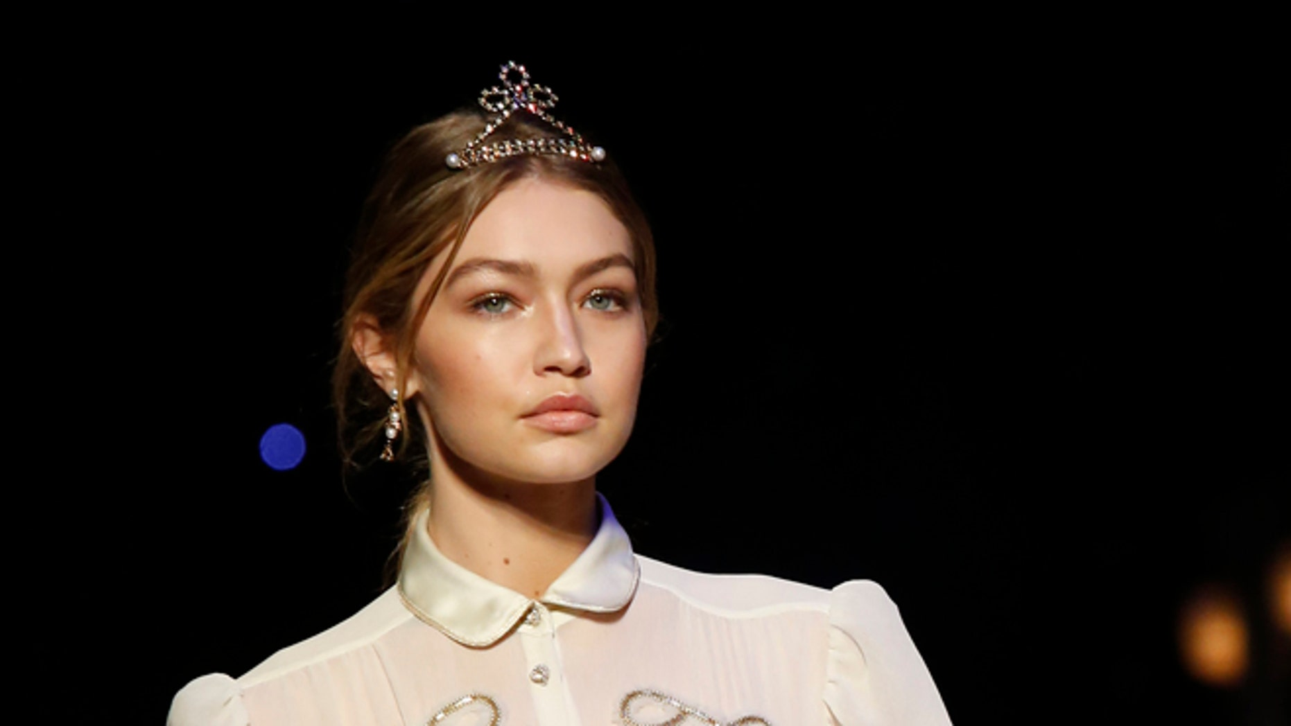 February 15, 2016. Model Gigi Hadid presents a creation from the Tommy Hilfiger Fall/Winter 2016 collection during New York Fashion Week.