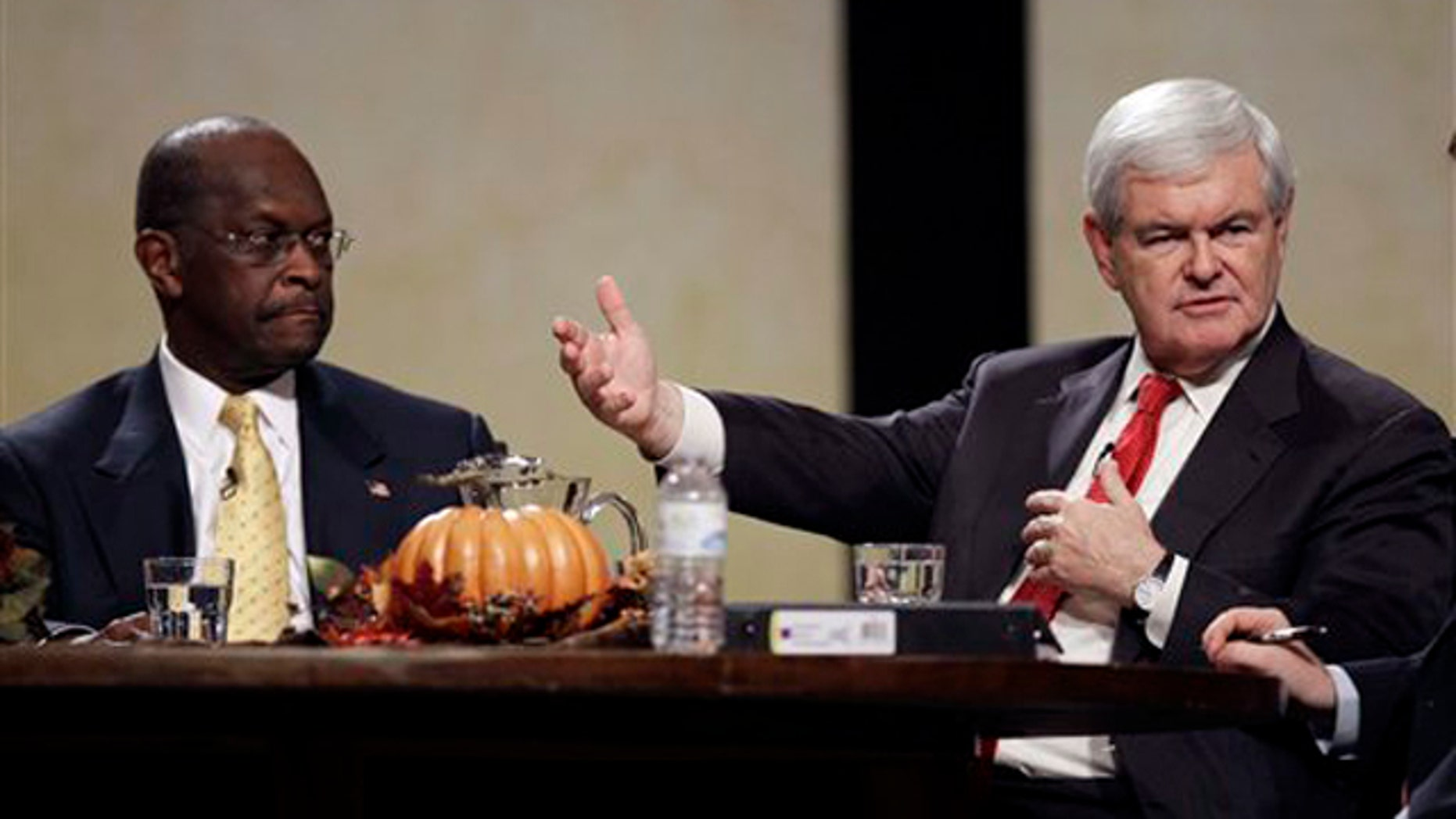 Nov. 19, 2011: Former House Speaker Newt Gingrich speaks during the Thanksgiving Family Forum, as former CEO of Godfather's Pizza Herman Cain looks on, in Des Moines, Iowa.