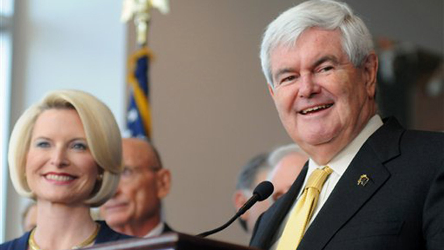 March 7, 2012: Newt Gingrich, accompanied by his wife Callista, speaks at a rally in Montgomery, Ala.