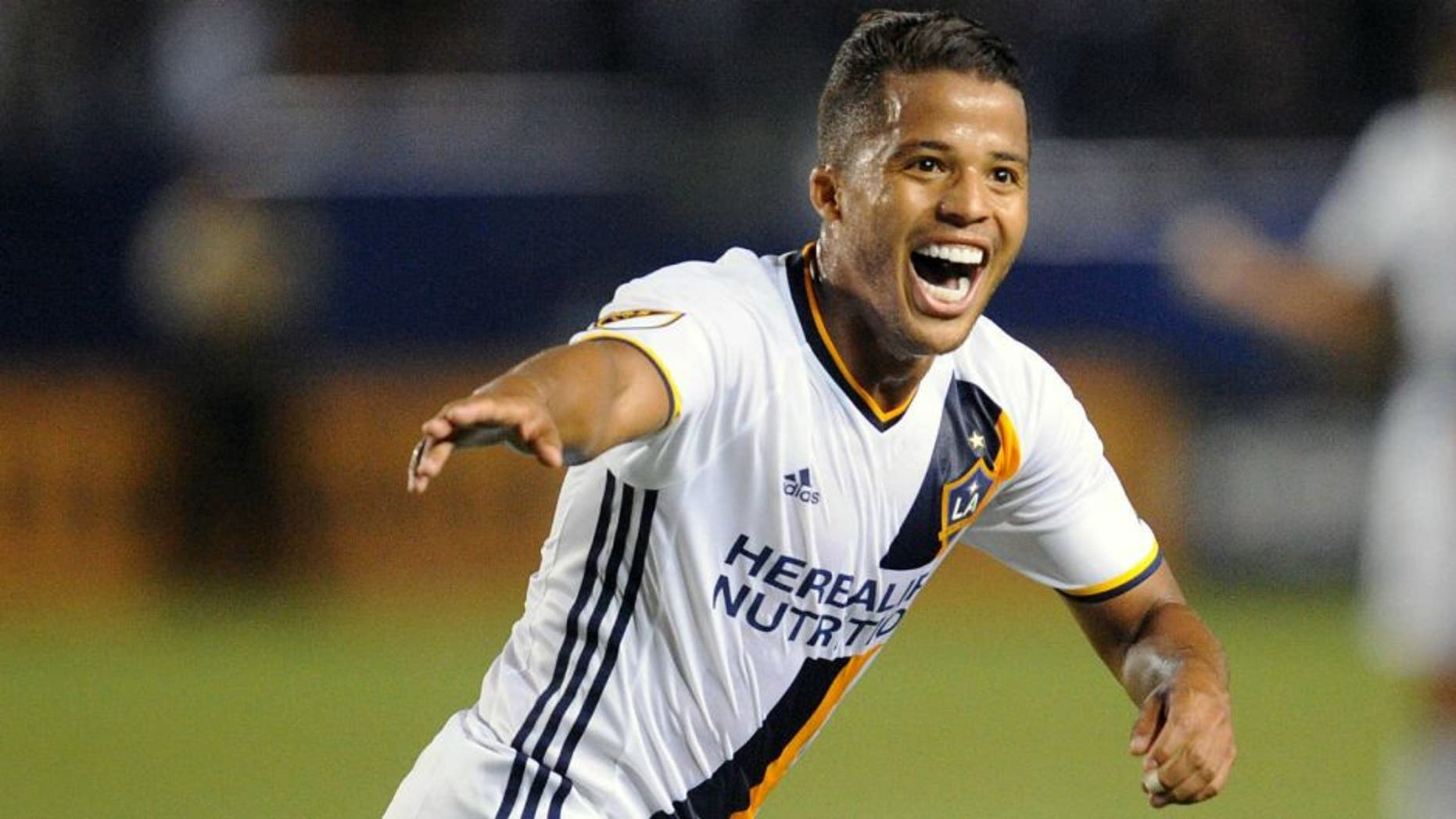 April 23, 2016; Carson, CA, USA; Los Angeles Galaxy forward Giovani dos Santos (10) celebrates his goal scored against Real Salt Lake during the first half at StubHub Center. Mandatory Credit: Gary A. Vasquez-USA TODAY Sports