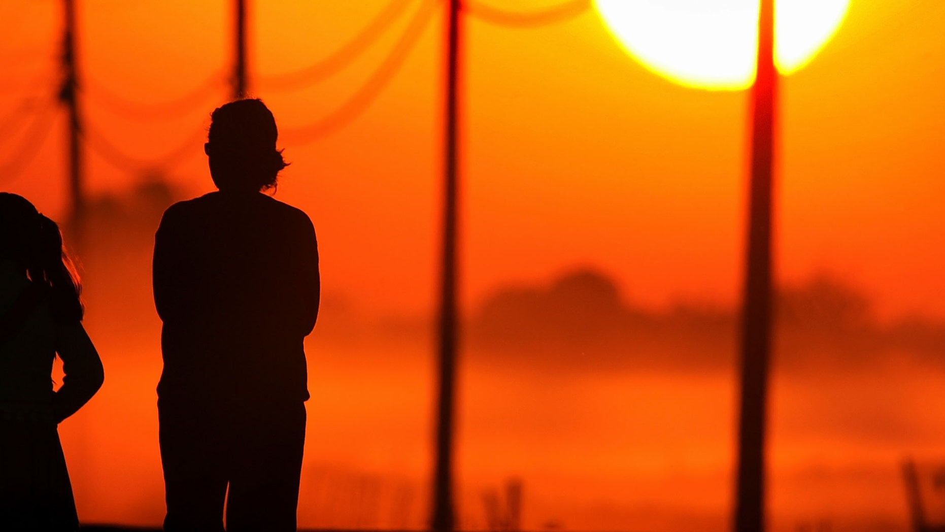 STOCKTON, CA - SEPTEMBER 29:  A young girl walks to her school bus stop at sunrise with another person on Bethel Island, one of the residential islands surrounded by levees that hold back the higher waters of the Sacramento-San Joaquin River Delta on September 29, 2005 west of Stockton, California. Officials say that the dikes of the Sacramento-San Joaquin River Delta are in worse shape than those that broke and flooded New Orleans during Hurricane Katrina. There is a two-in-three chance that a catastrophic earthquake or storm in the next 50 years may damage the levees enough to cause the kind of destruction that engulfed New Orleans, according to experts. Such an event would affect the water supply that serves two-thirds of California and create a nightmare traffic jam on Highway 4, the two-lane road that would be the major evacuation route, if it is not damaged beyond usability. Approximately 1,600 miles of levees protect the delta's islands, which lie well below sea-level, and most were built more than 100 years ago.  (Photo by David McNew/Getty Images)