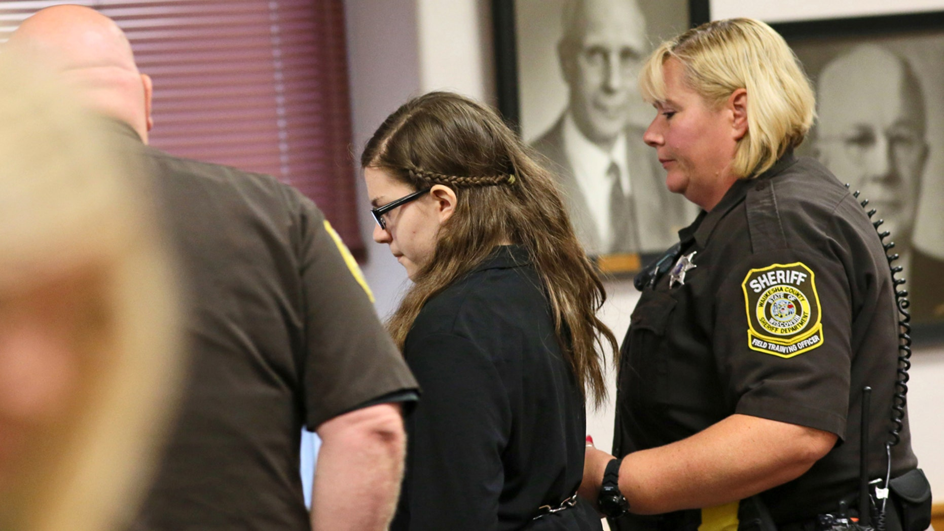 Sept. 9, 2016: Anissa Weier, accused of trying to kill a classmate to please horror character Slender Man, is led out of Waukesha County Circuit Court in Waukesha, Wis.