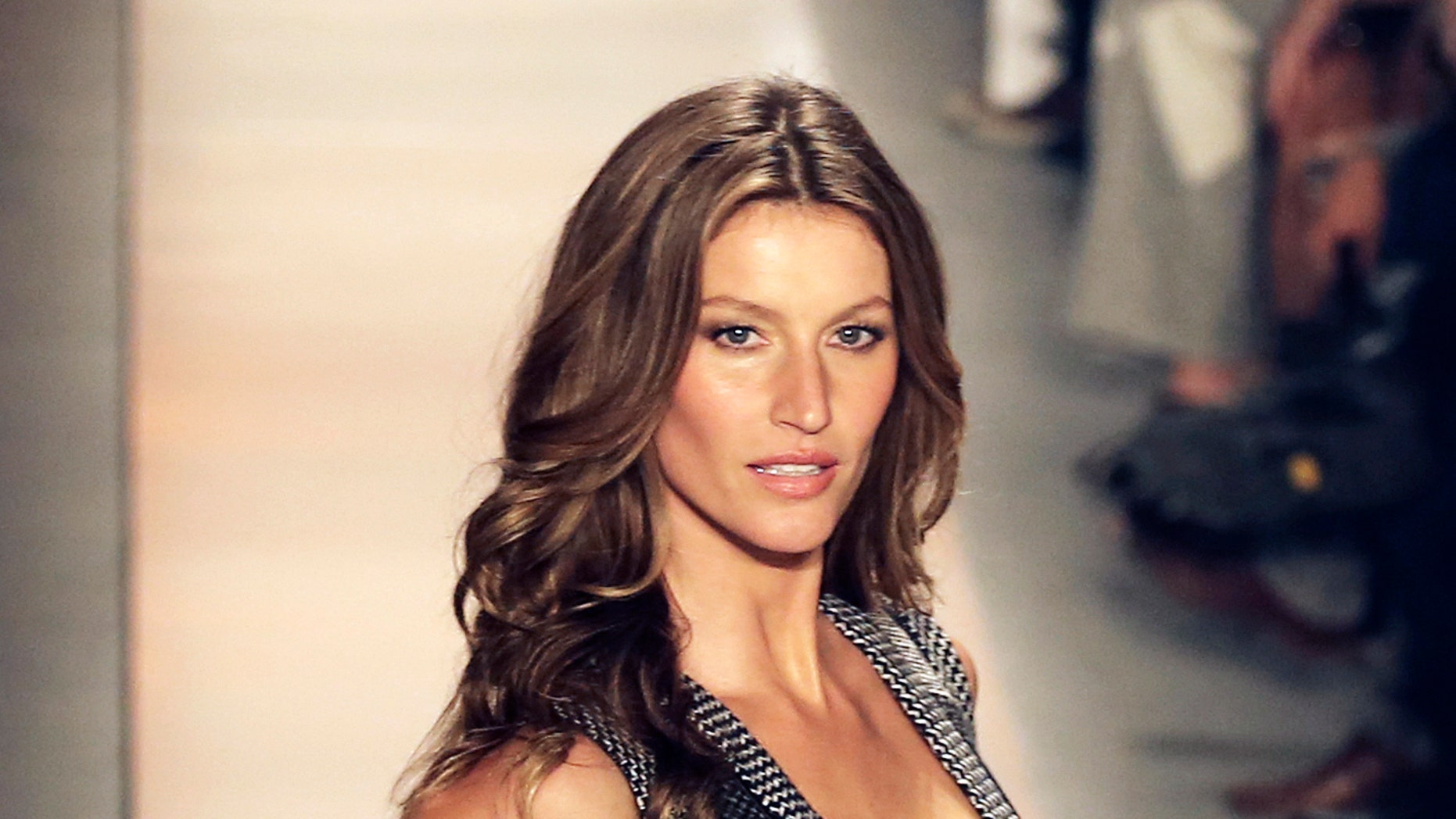 October 31, 2013. Brazilian model Gisele Bundchen presents a creation from Colcci Winter 2014 collection during Sao Paulo Fashion Week.