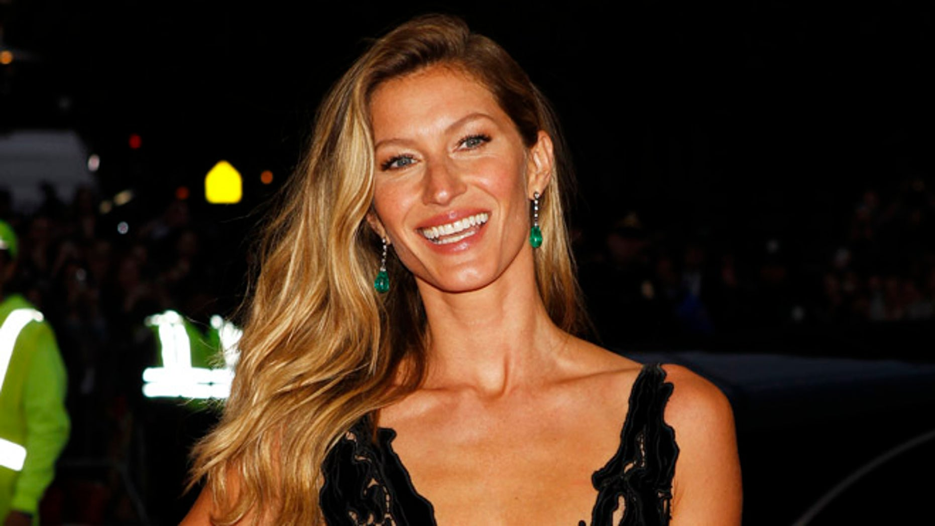 Gisele Bundchen posed in a tiny blue bikini in honor of Earth Day