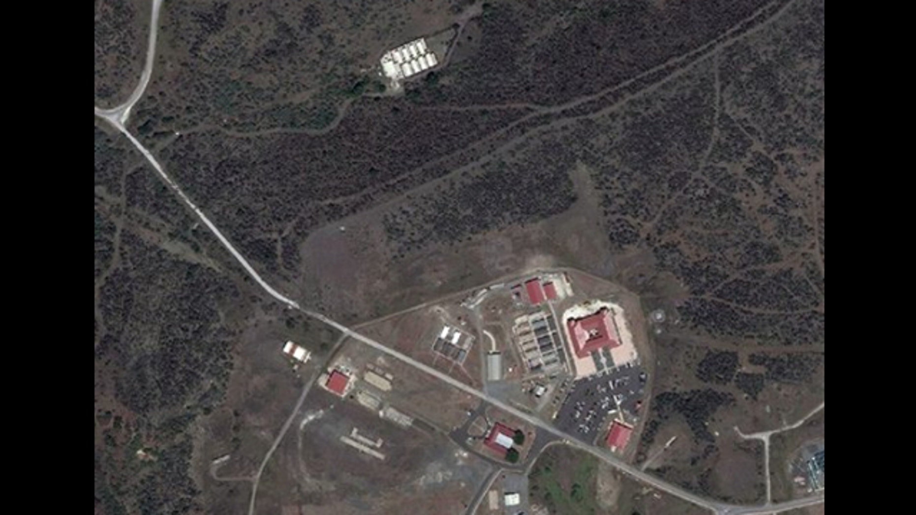 FILE: Sept. 2, 2010: This satellite image provided by TerraServer.com and DigitalGlobe shows a portion of Naval Station Guantanamo Bay, Cuba, including the secret facility known as Penny Lane, upper in white.