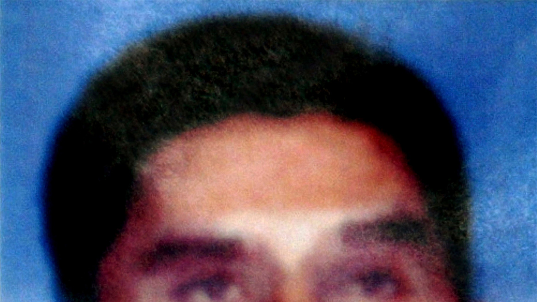 FILE - In this file photo released by Indonesian National Police on Aug. 21, 2003, Southeast Asian terror mastermind Hambali is shown.