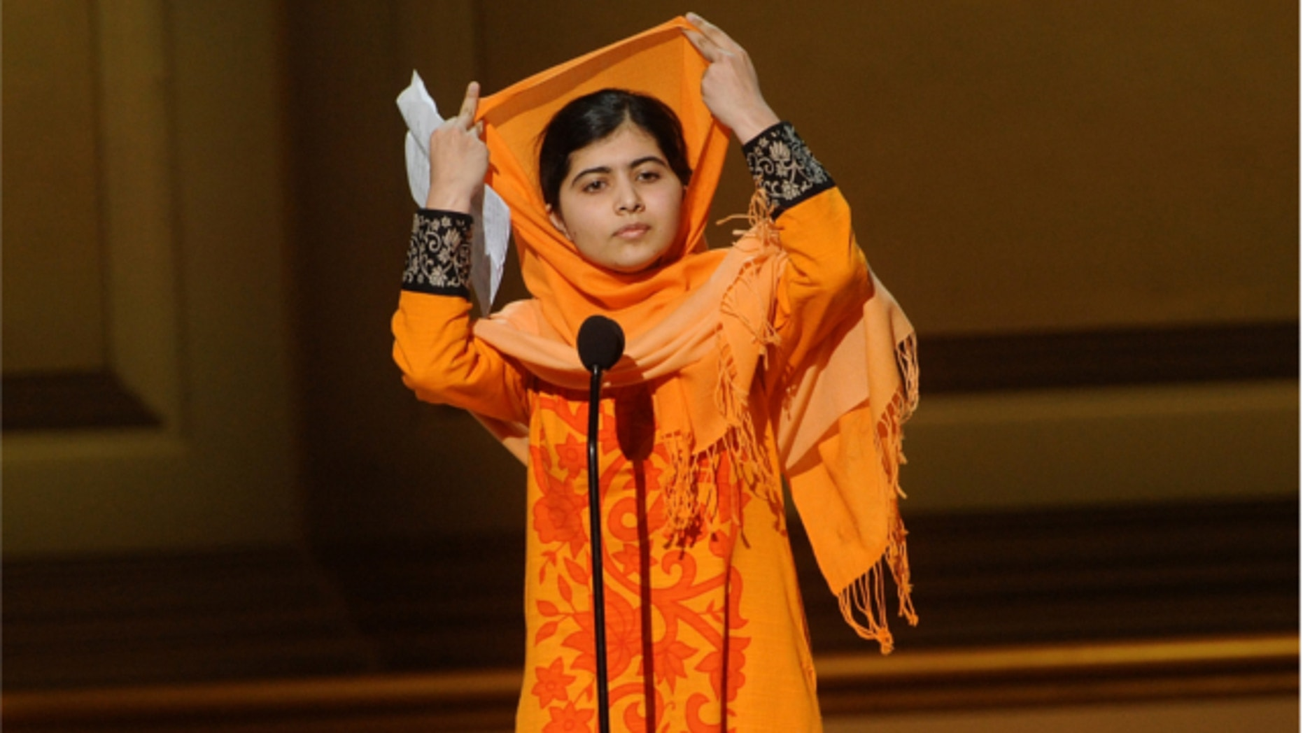 Nov. 11, 2013: Education activist Malala Yousafzai accepts The Women of the Year Fund Honoree Award on stage at the 2013 Glamour Women of the Year Awards in New York.