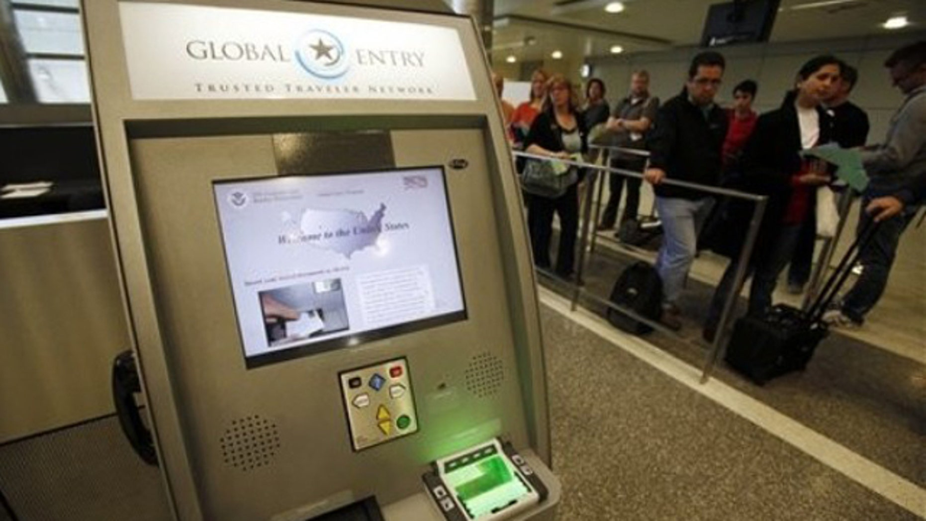A Global Entry Trusted Traveler Network kiosk awaits arriving international passengers who are registered for the service at the newly-renovated customs clearance area at the Tom Bradley International Terminal at Los Angeles International Airport. (AP Photo/Reed Saxon)