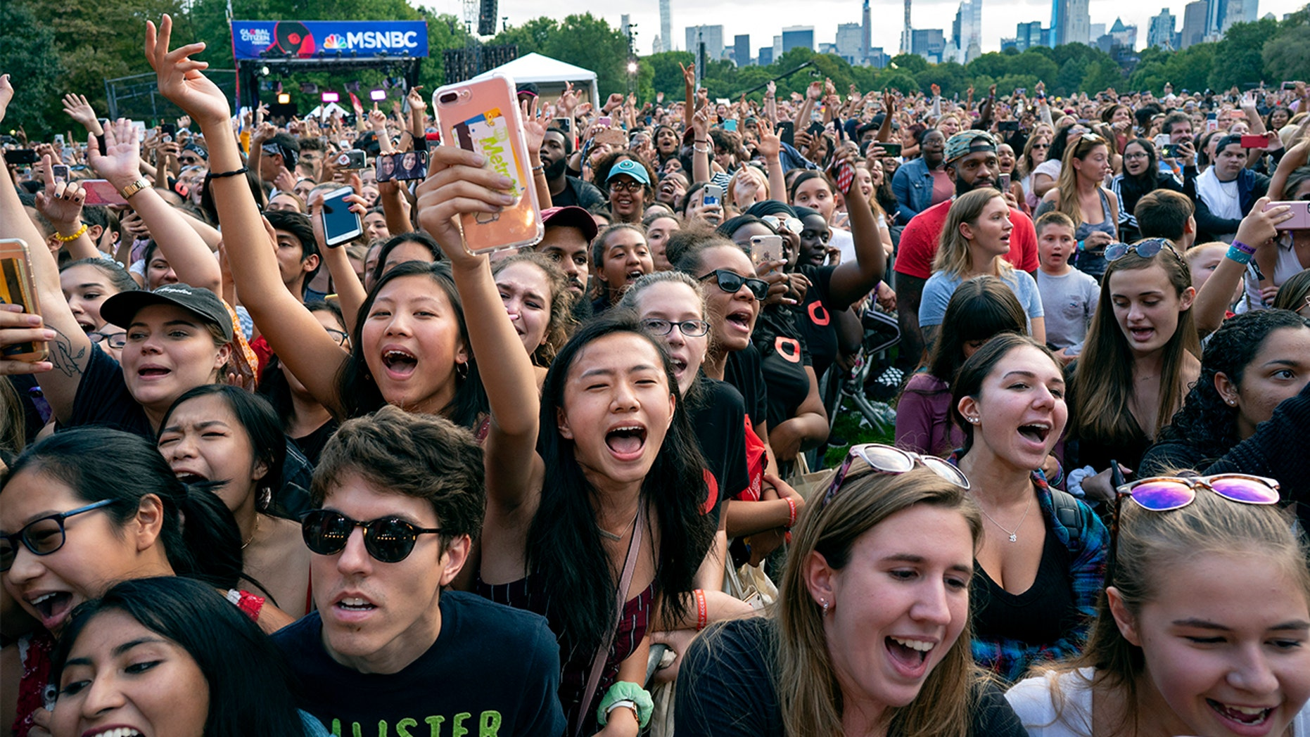 Festival goers watch a performance during the 2018 Global Citizen Festival Saturday, Sept. 29, 2018, in New York. (AP Photo/Craig Ruttle)