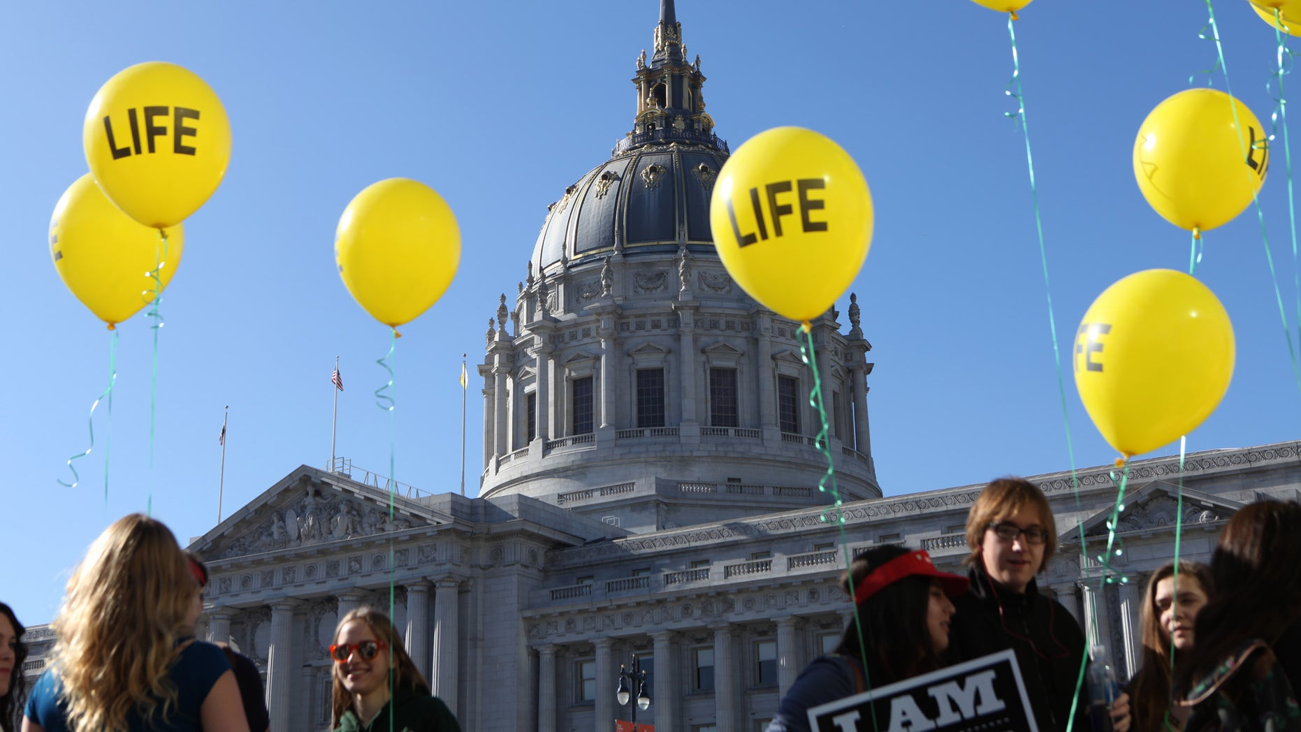 "Members of the St. Rose of Lima Parish of Paso Robles Calif. arrive to the ""Walk for Life"" rally and march in San Francisco on Saturday, Jan. 24, 2015. Thousands of abortion opponents gathered at Civic Center Plaza in front of City Hall for the 11th annual event before marching down Market Street to Justin Herman Plaza. (AP Photo/Alex Washburn)"