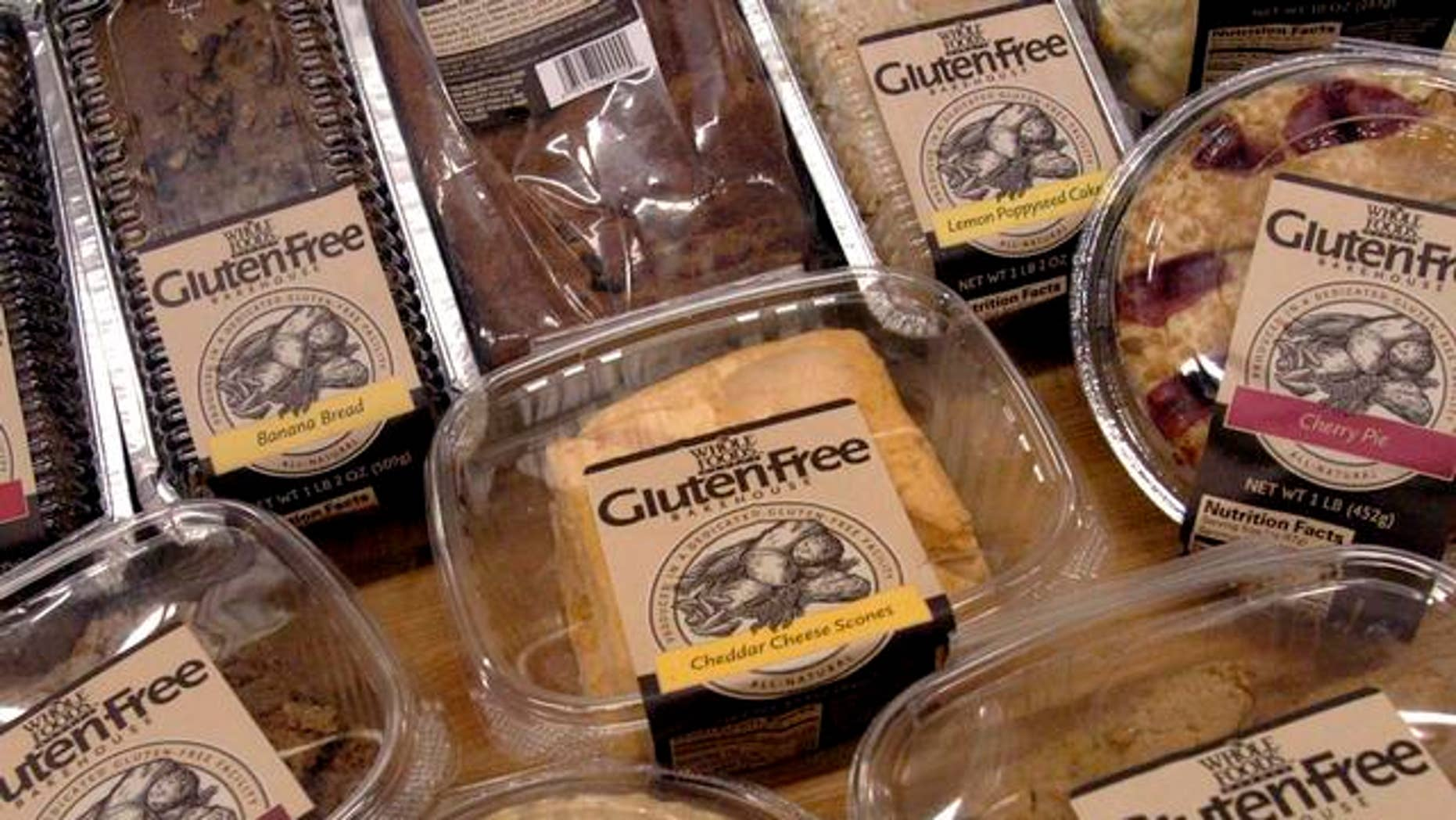"""** FILE ** A sample of some of the 27 gluten-free products are displayed, in this Oct. 5, 2004 file photo, at the Whole Foods Market Gluten-Free Bakehouse in Morrisville, N.C. Each label reads """"Produced in a Dedicated Gluten-Free Facility."""" Once banished to the dusty bottom shelves of obscure grocers, the gluten-free revolution is surfacing in the aisles of major supermarkets. (AP Photo/Karen Tam)"""
