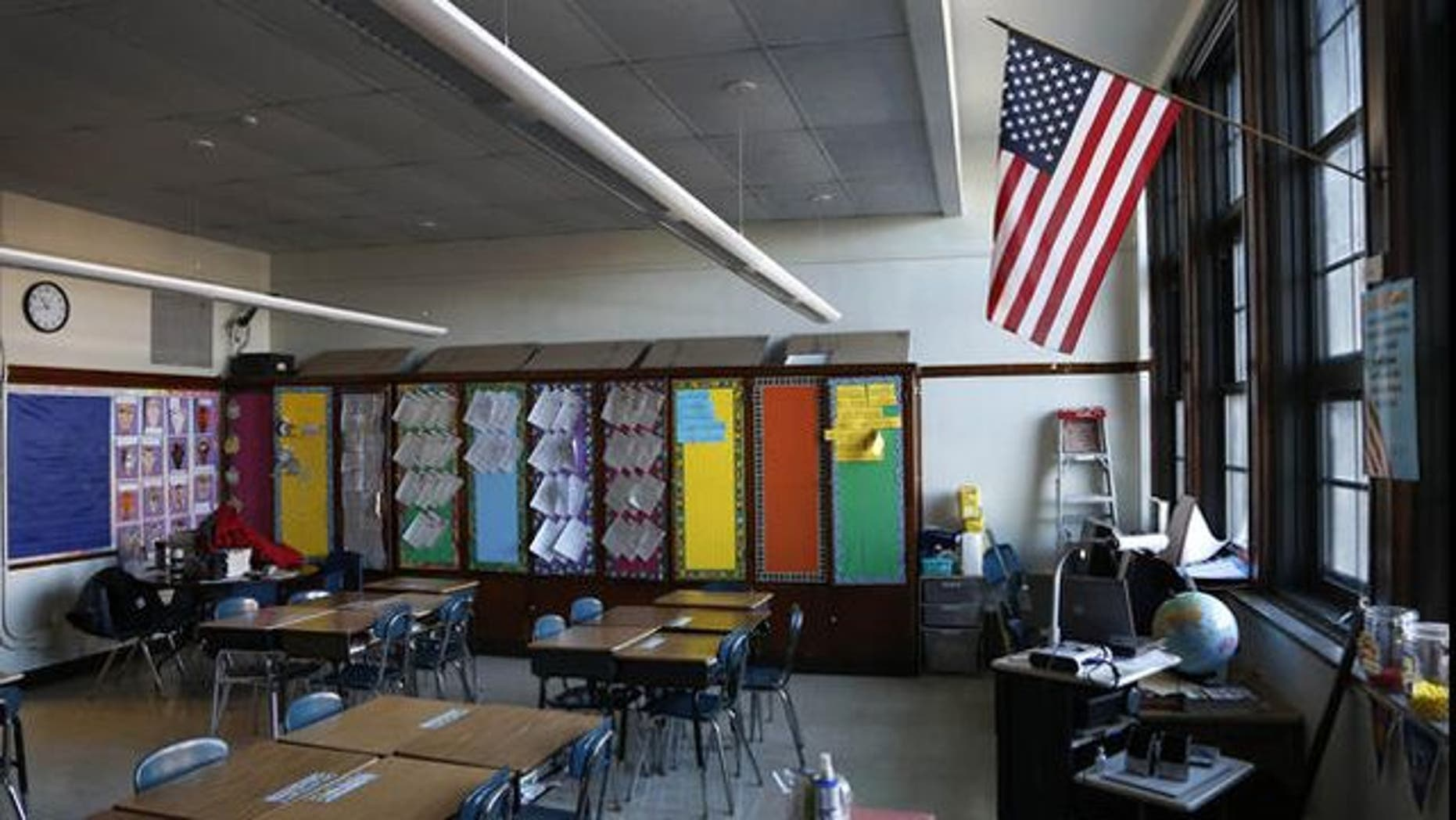 """FILE: Lawmakers in Pennsylvania are considering a bill that would require public school districts to post """"In God We Trust"""" in every school building."""