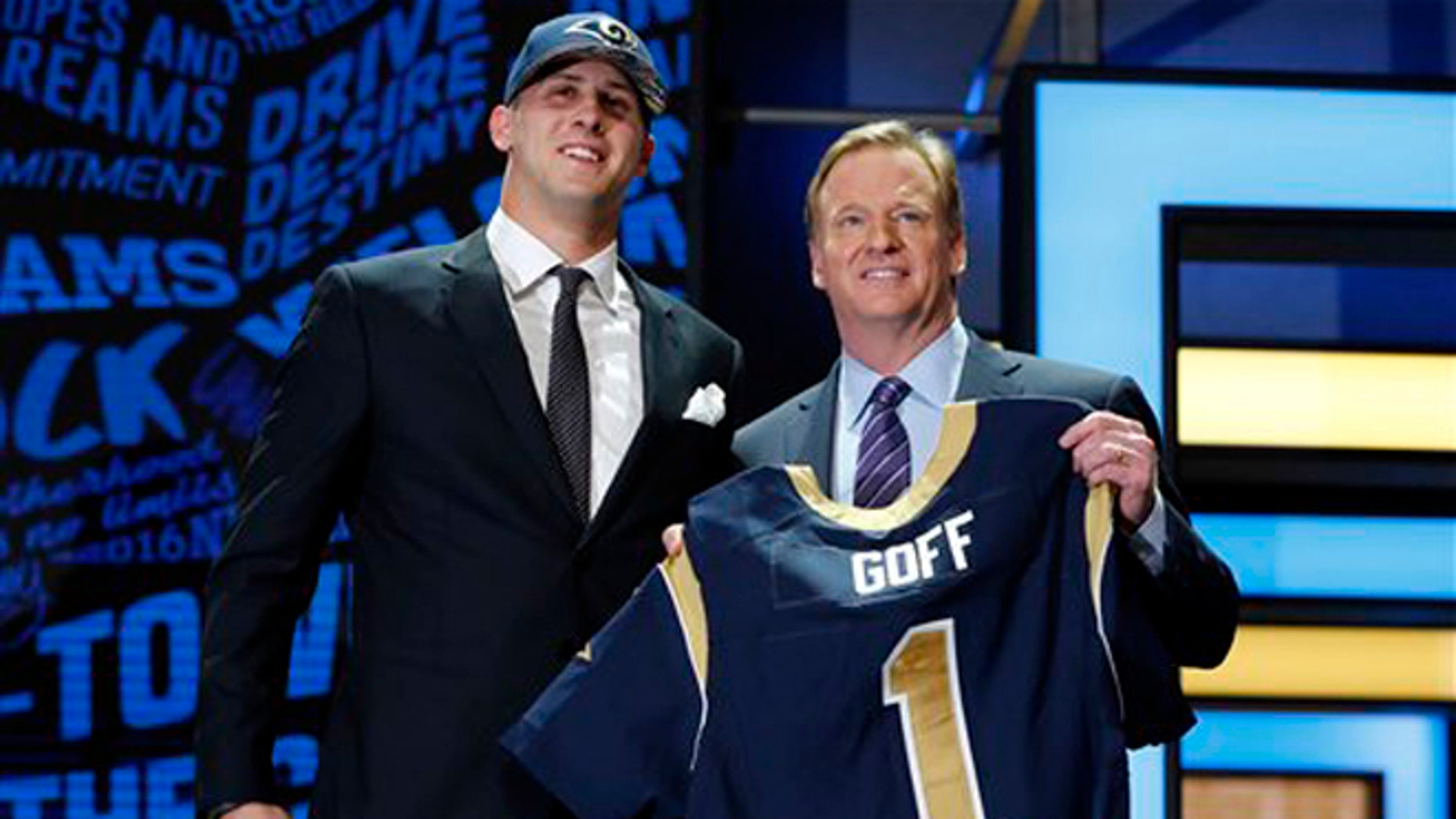 California s Jared Goff poses for photos with NFL commissioner Roger  Goodell after being selected by the 2479d71a4