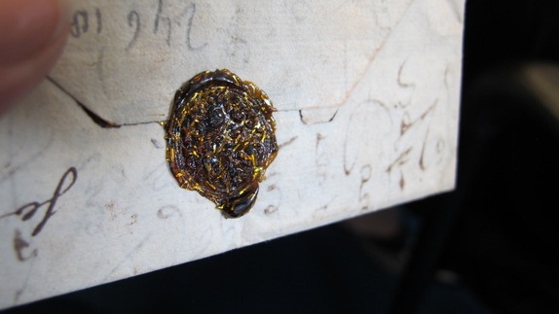 The Brienne trunk contained hundreds of unopened letters. Thie one features a gold wax seal.