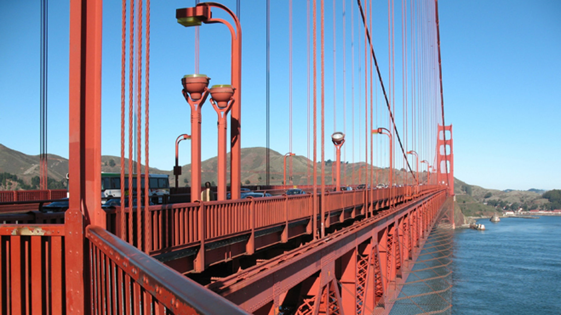 This undated artist rendering provided by the Golden Gate Bridge authorities shows the proposed netting suicide barrier that is to be installed under the iconic bridge in San Francisco.