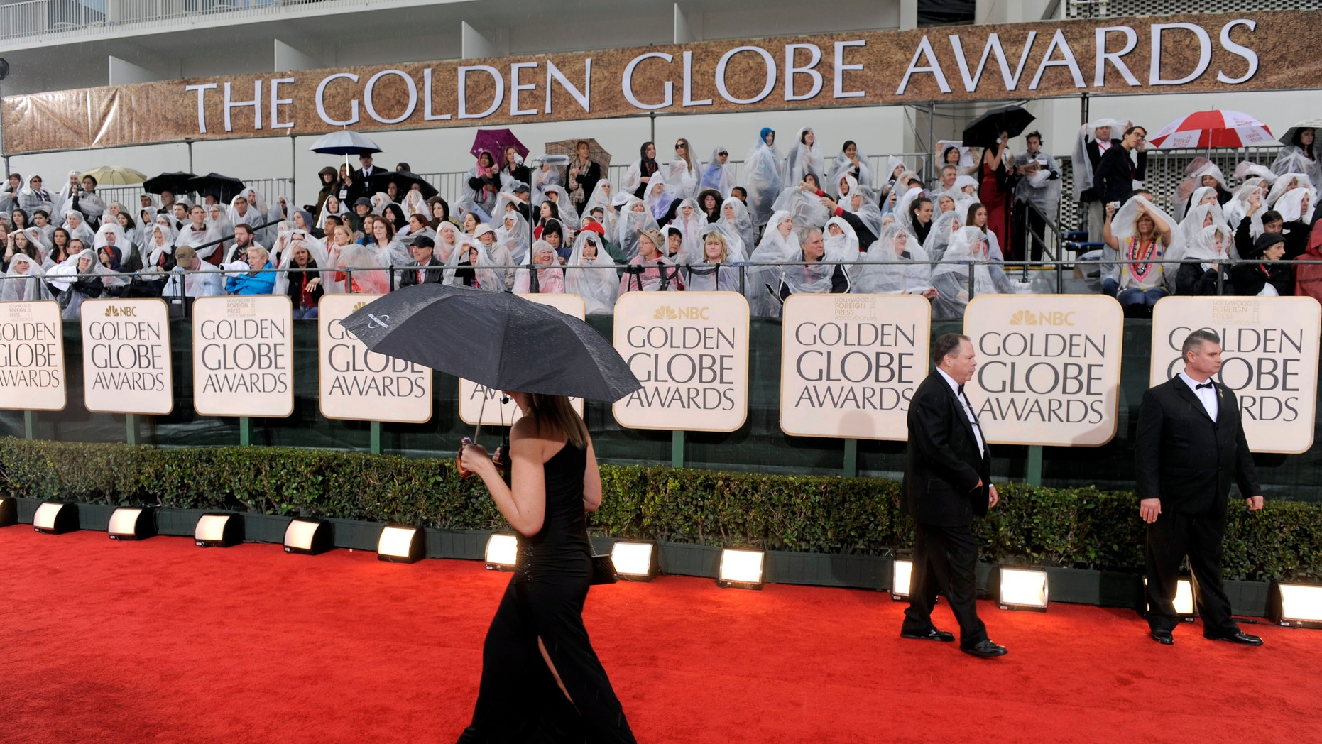 Jan. 17, 2010. A  publicist walks down the red carpet as it rains before the 67th Annual Golden Globe Awards in Beverly Hills, Calif.
