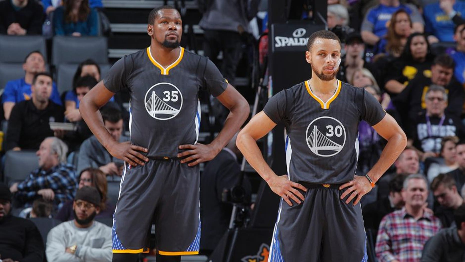 SACRAMENTO, CA - FEBRUARY 4: Kevin Durant #35 and Stephen Curry #30 of the Golden State Warriors look on during the game against the Sacramento Kings on February 4, 2017 at Golden 1 Center in Sacramento, California. NOTE TO USER: User expressly acknowledges and agrees that, by downloading and or using this photograph, User is consenting to the terms and conditions of the Getty Images Agreement. Mandatory Copyright Notice: Copyright 2017 NBAE (Photo by Rocky Widner/NBAE via Getty Images)