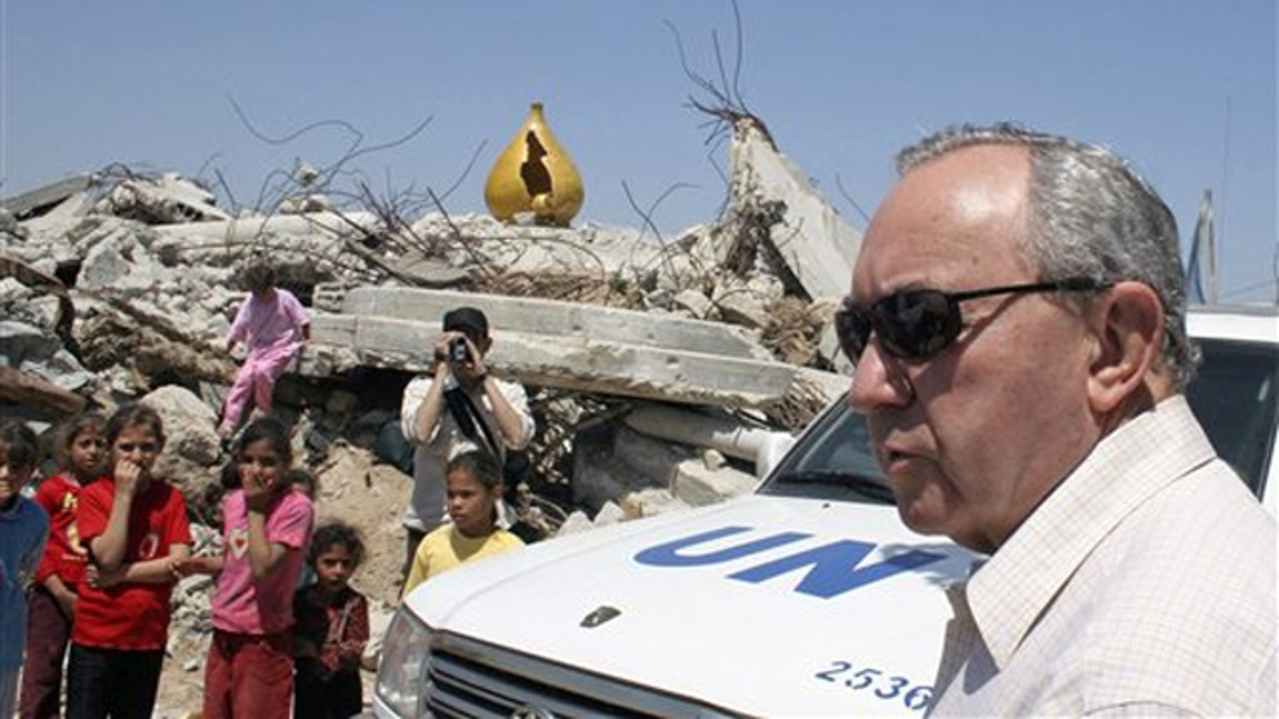 FILE: In this June 3, 2009, photo, U.N. investigator Richard Goldstone visits a house destroyed during an artillery strike during Israel's offensive in January 2009 in Gaza City.