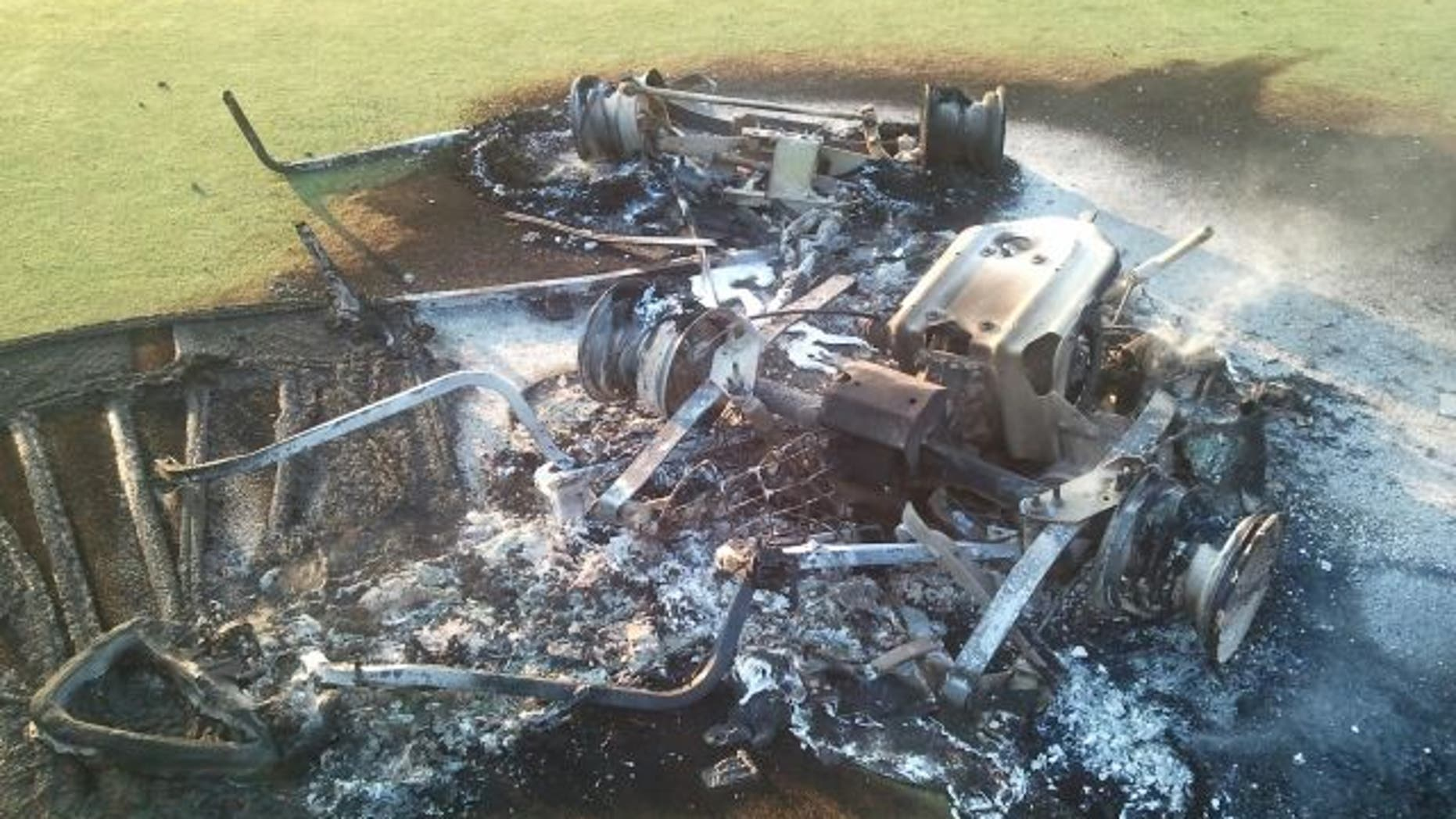 This undated photo shows a damaged golf cart.