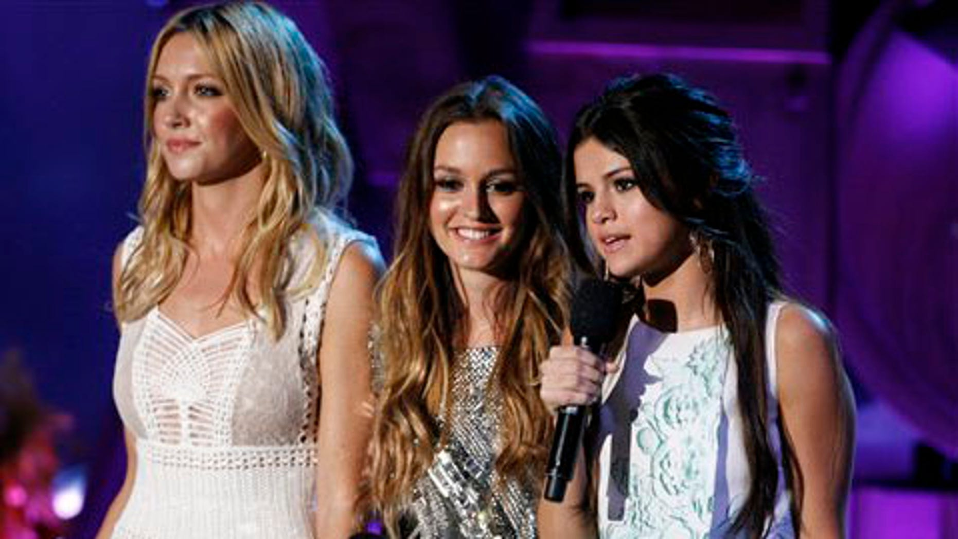 From left to right: Katie Cassidy, Leighton Meester, and Selena Gomez at the MTV Movie Awards.
