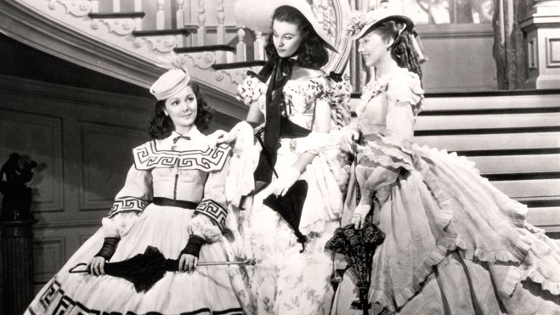 """This undated image from the film """"Gone with the Wind"""" provided by New Line Cinema shows, from left, Ann Rutherford, Vivien Leigh and Evelyn Keyes."""