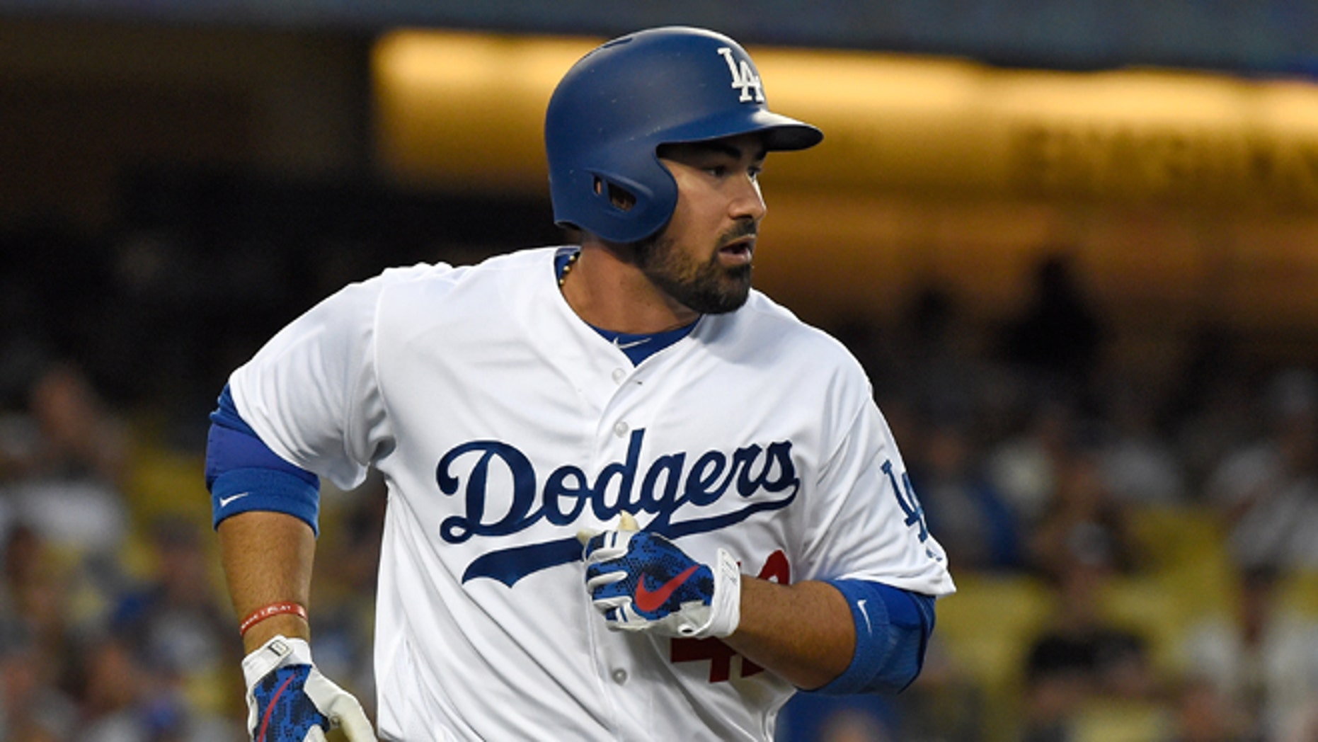 LOS ANGELES, CA - APRIL 15:  Adrian Gonzalez #42 of the Los Angeles Dodgers runs to first base after hitting a single in the first inning against the San Francisco Giants at Dodger Stadium on April 15, 2016 in Los Angeles, California.  (Photo by Lisa Blumenfeld/Getty Images)