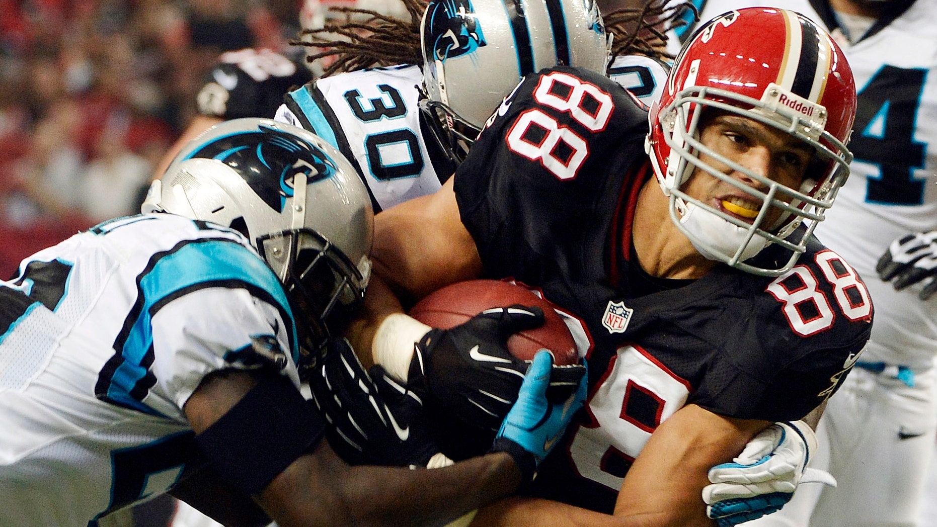 FILE - In this Sept. 30, 2012, file photo, Atlanta Falcons tight end Tony Gonzalez (88) fights for extra yardage during the first half of an NFL football game against the Carolina Panthers in Atlanta. Gonzalez wants to go out with a ring. First, he's got to win a playoff game. In what he keeps insisting will likely be his final season, the Falcons' age-defying tight end is looking forward to taking another shot at his first postseason victory. (AP Photo/Rich Addicks, File)
