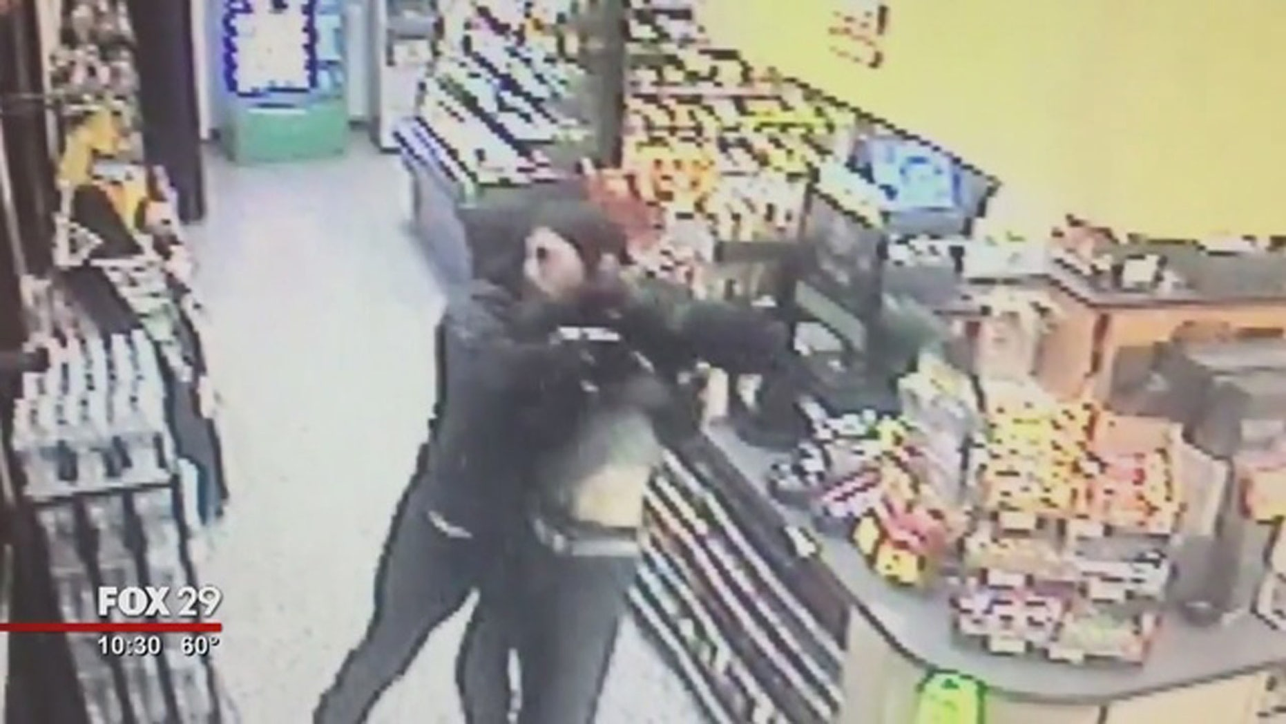 A Good Samaritan was captured via surveillance video fighting an armed man who police say robbed a Wawa store.