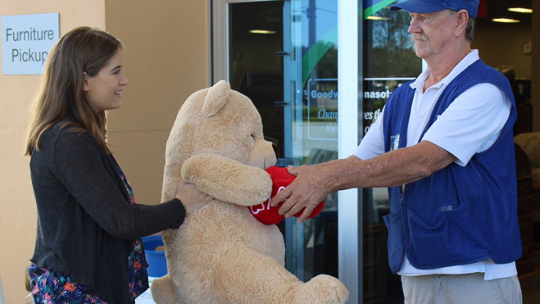 Amanda Emory drops off a giant Valentine's Day teddy bear from her ex-boyfriend to Goodwill Manasota's Tom Lohr. (Goodwill Manasota)