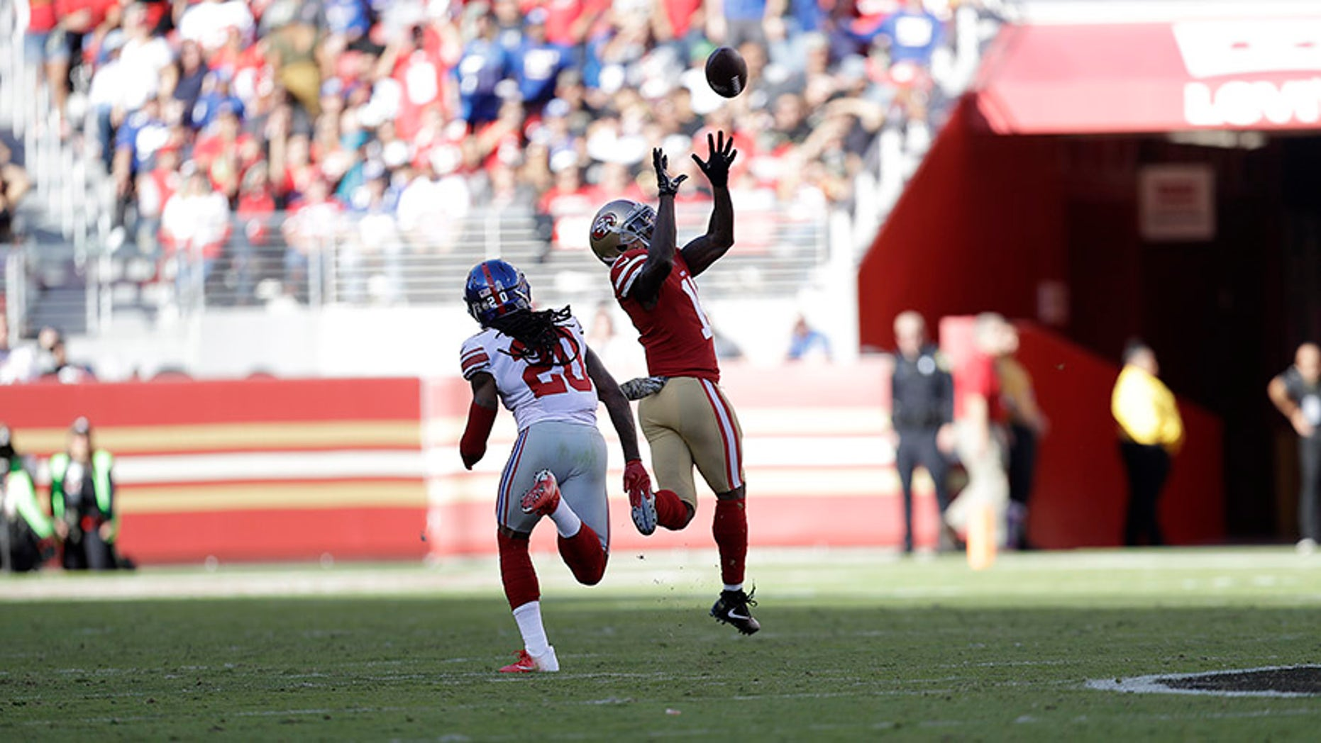 Nov. 12, 2017: San Francisco 49ers wide receiver Marquise Goodwin catches a touchdown pass in front of New York Giants cornerback Janoris Jenkins during the first half of a game in Santa Clara, Calif.,