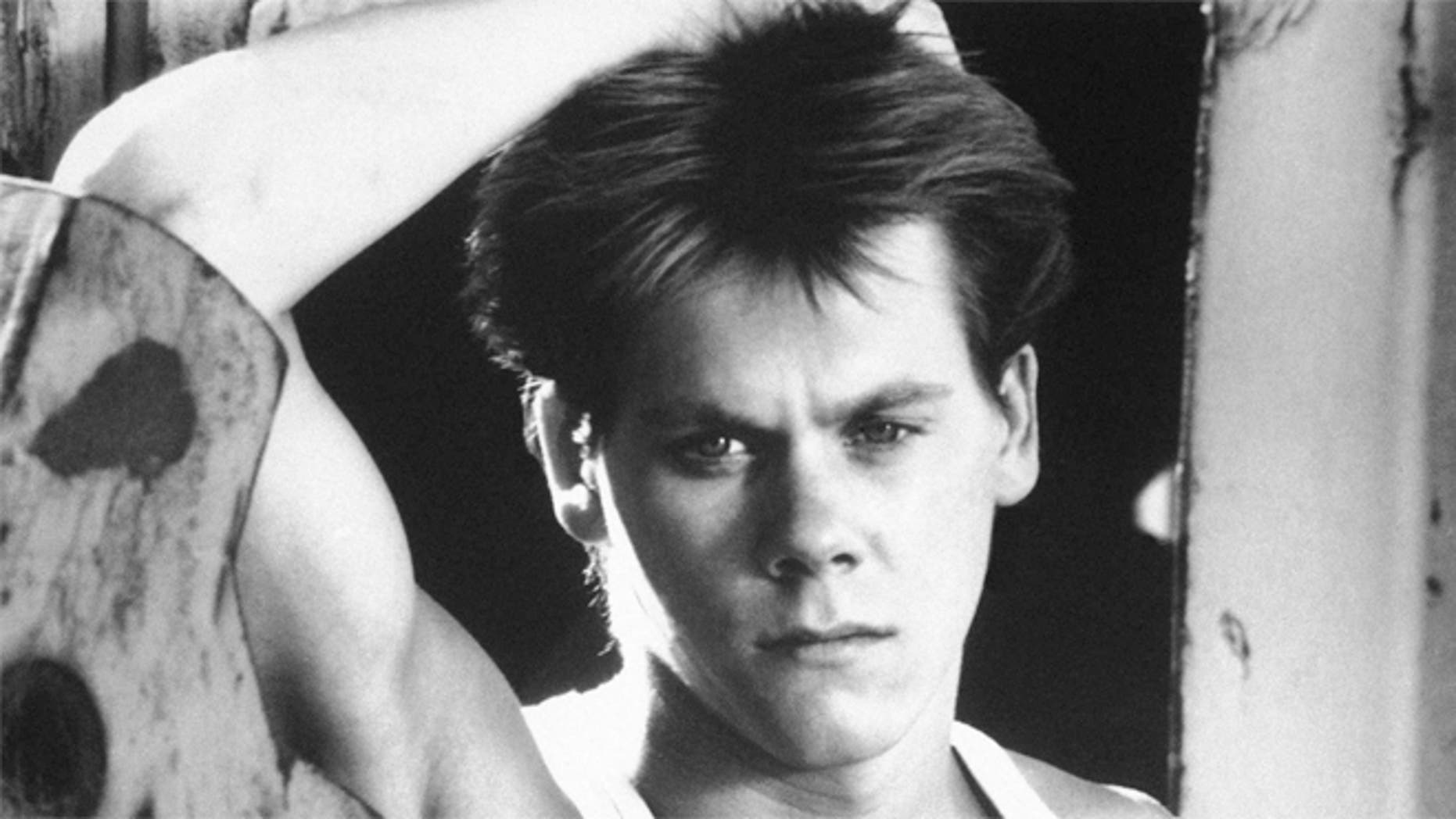 "Kevin Bacon is shown in a scene from the movie ""Footloose."""