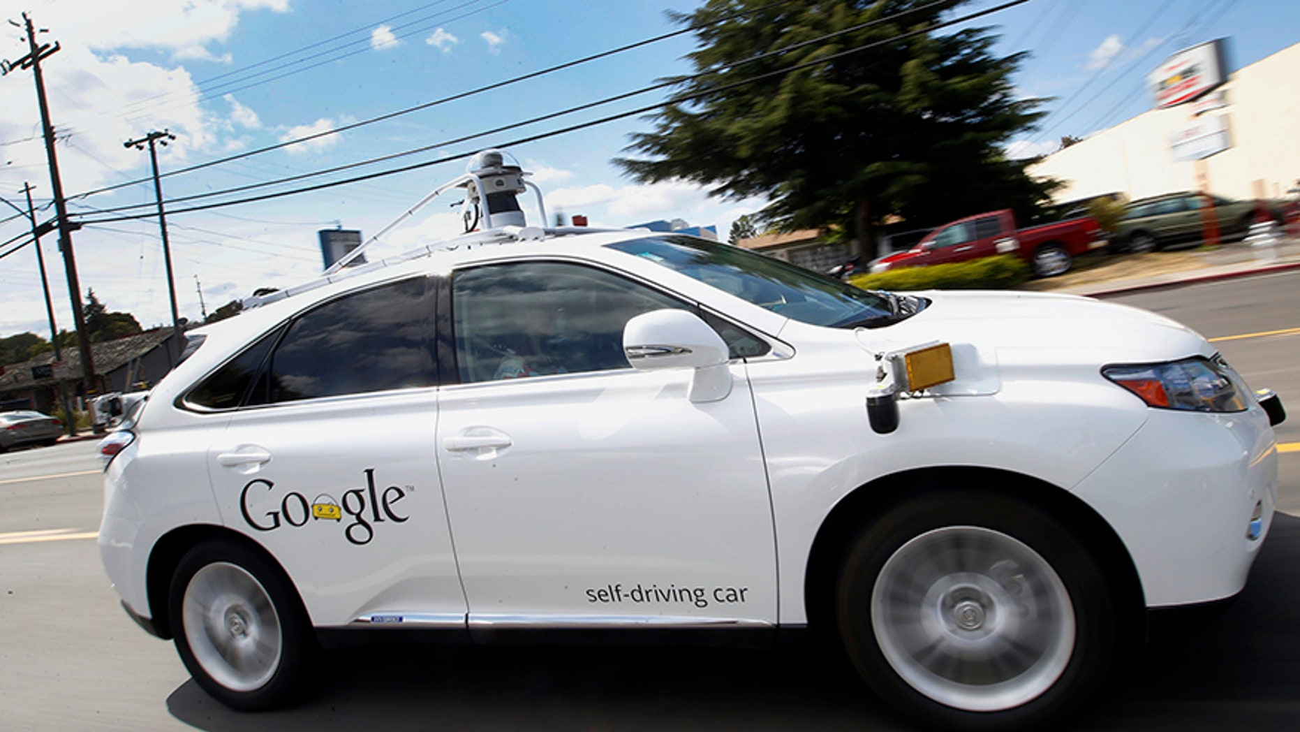 FILE - In this May 13, 2015 file photo, Google's self-driving Lexus car drives along street during a demonstration at Google campus in Mountain View, Calif. A House panel on Wednesday, July 19, 2017, backed legislation designed to allow automakers to increase the testing of self-driving cars on U.S. roads. (AP Photo/Tony Avelar, File)