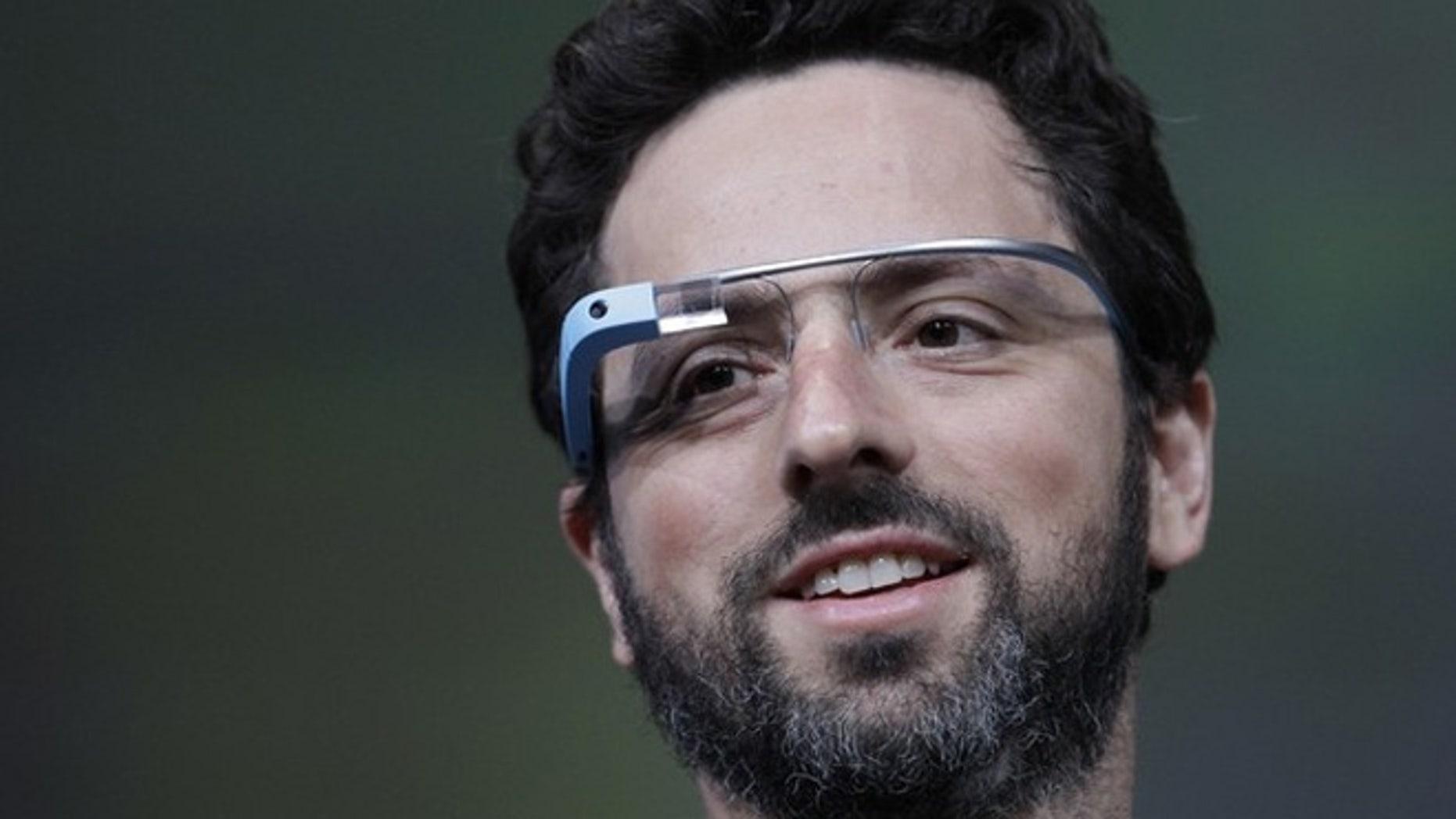 Google co-founder Sergei Brin shows off Google Glass.