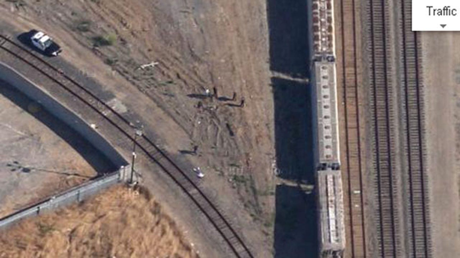 This photo from Google Maps shows investigators surrounding the body of 14-year-old Kevin Barrera in 2009 (Google Maps)