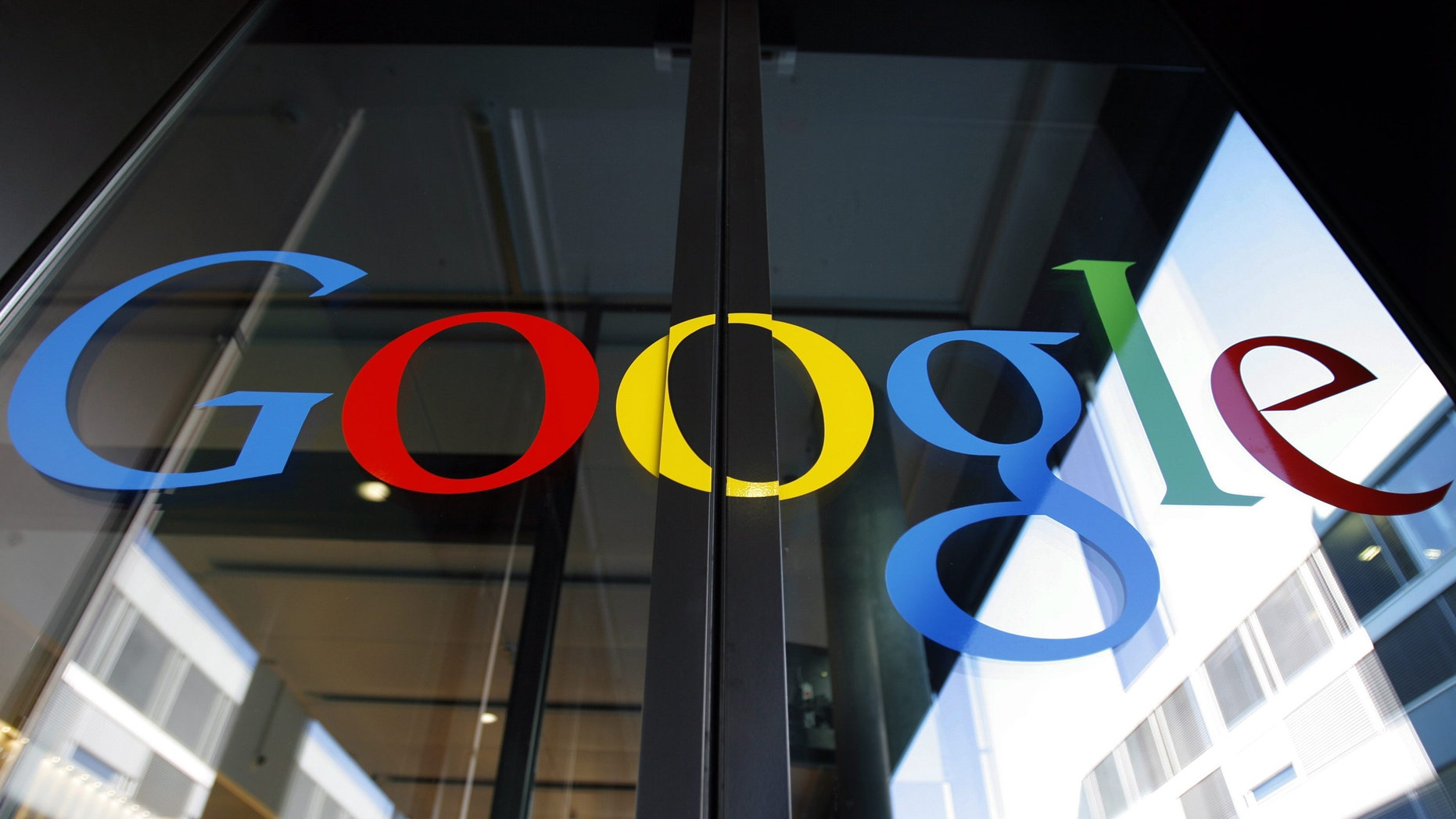 FILE - In this March 6, 2008 file photo, the Google logo is seen on the front door of the new Google Engineering center in Zurich, Switzerland. European regulators appeared on Tuesday, Oct. 1, 2013 to be nearing a settlement with Google in their probe over whether the Internet search and advertising giant is unfairly stifling competition. (AP Photo/Keystone, Walter Bier, File)