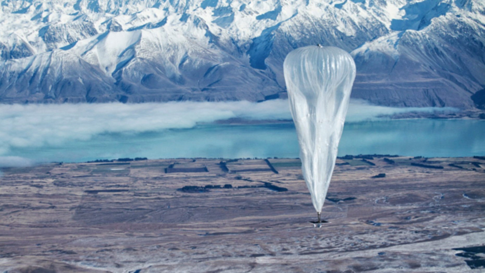 June 10, 2013: A Google balloon sails through the air with the Southern Alps mountains in the background, in Tekapo, New Zealand.