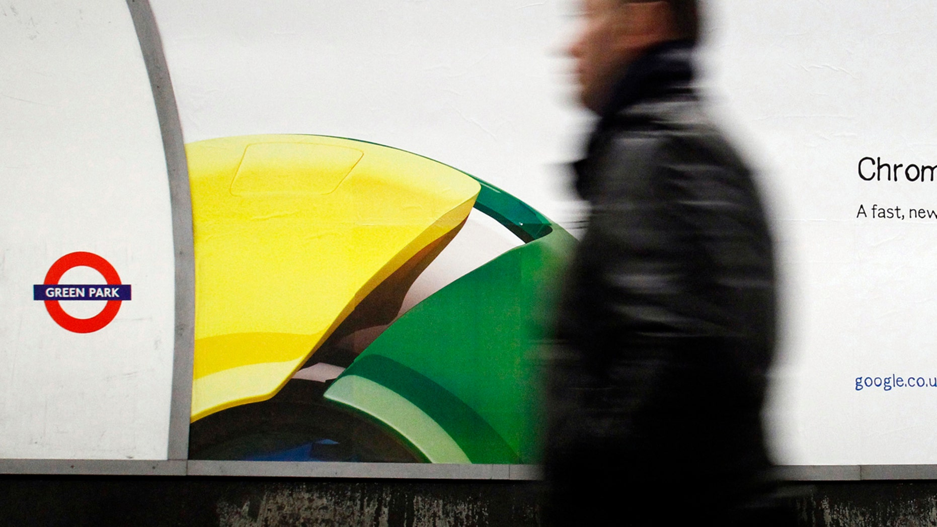 File photo - A man walks past a poster for Google's Chrome browser in an underground station in central London Jan. 25, 2010. (REUTERS/Luke MacGregor)